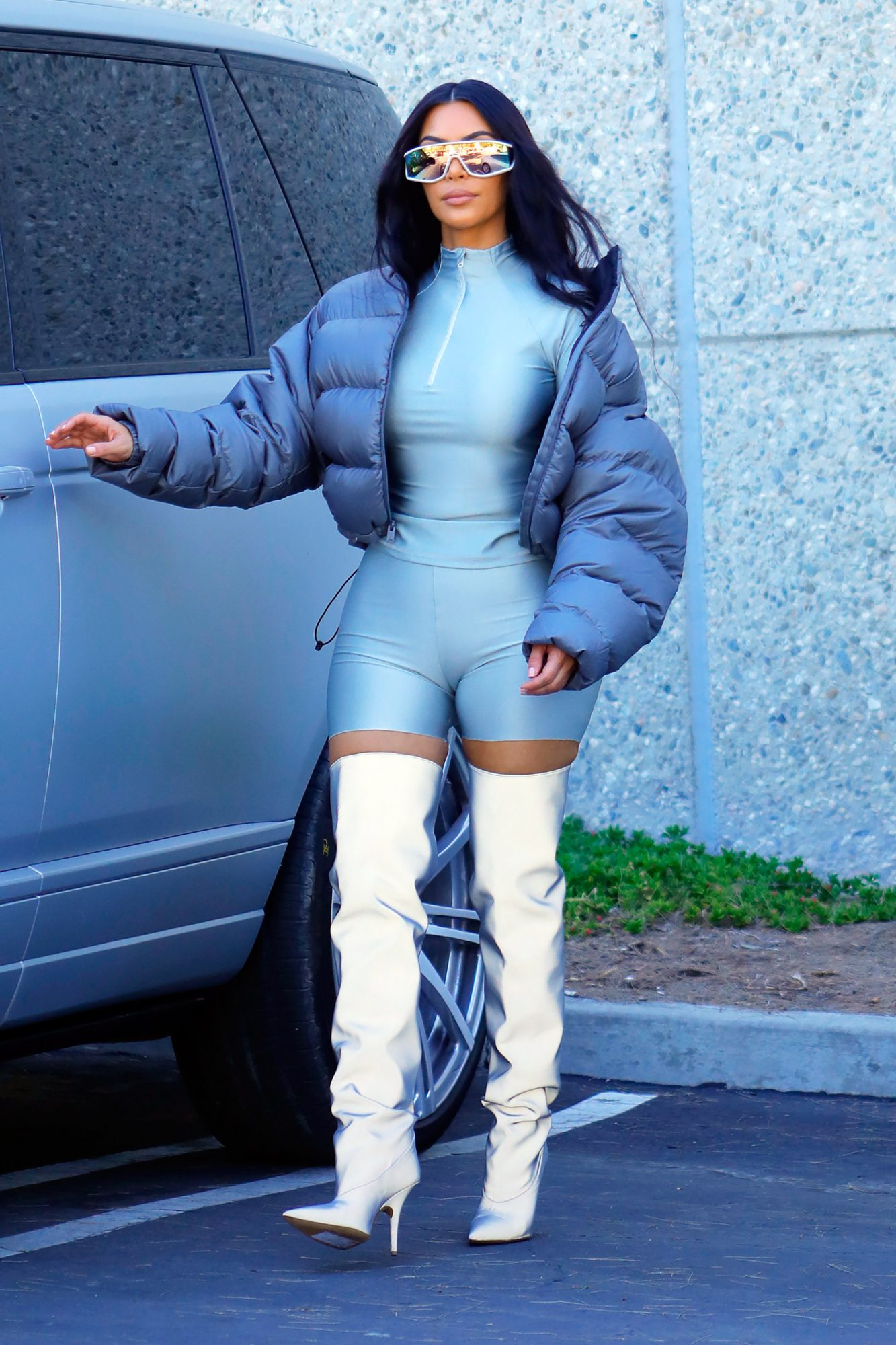 EXCLUSIVE: Kim Kardashian is seen arriving at an office building for a photoshoot wearing a futuristic look