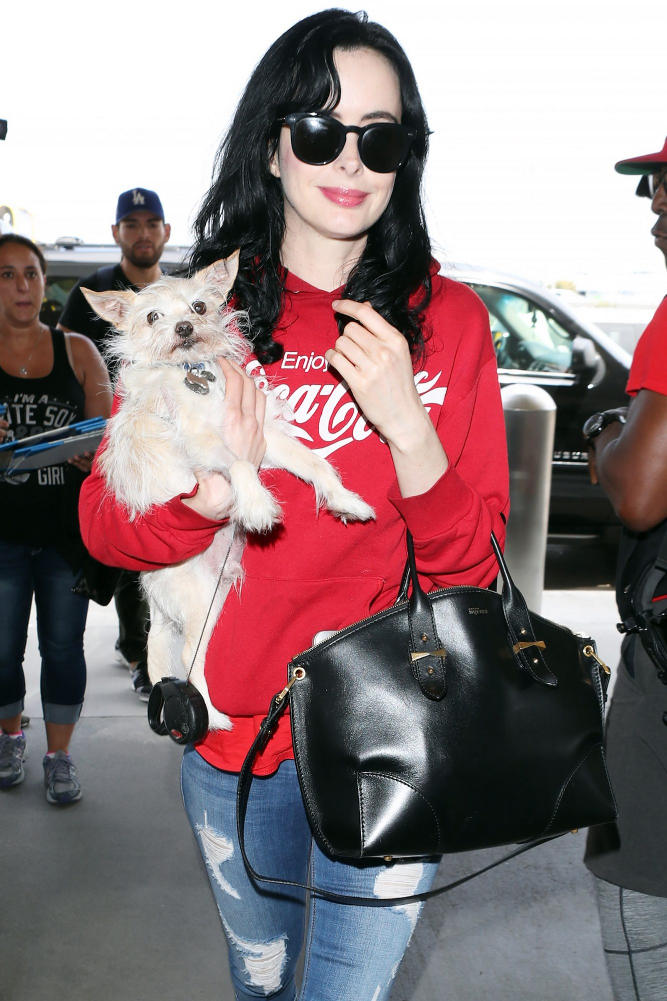 Krysten Ritter Who stars as Jessica Jones Departs LAX airport  with lil pup