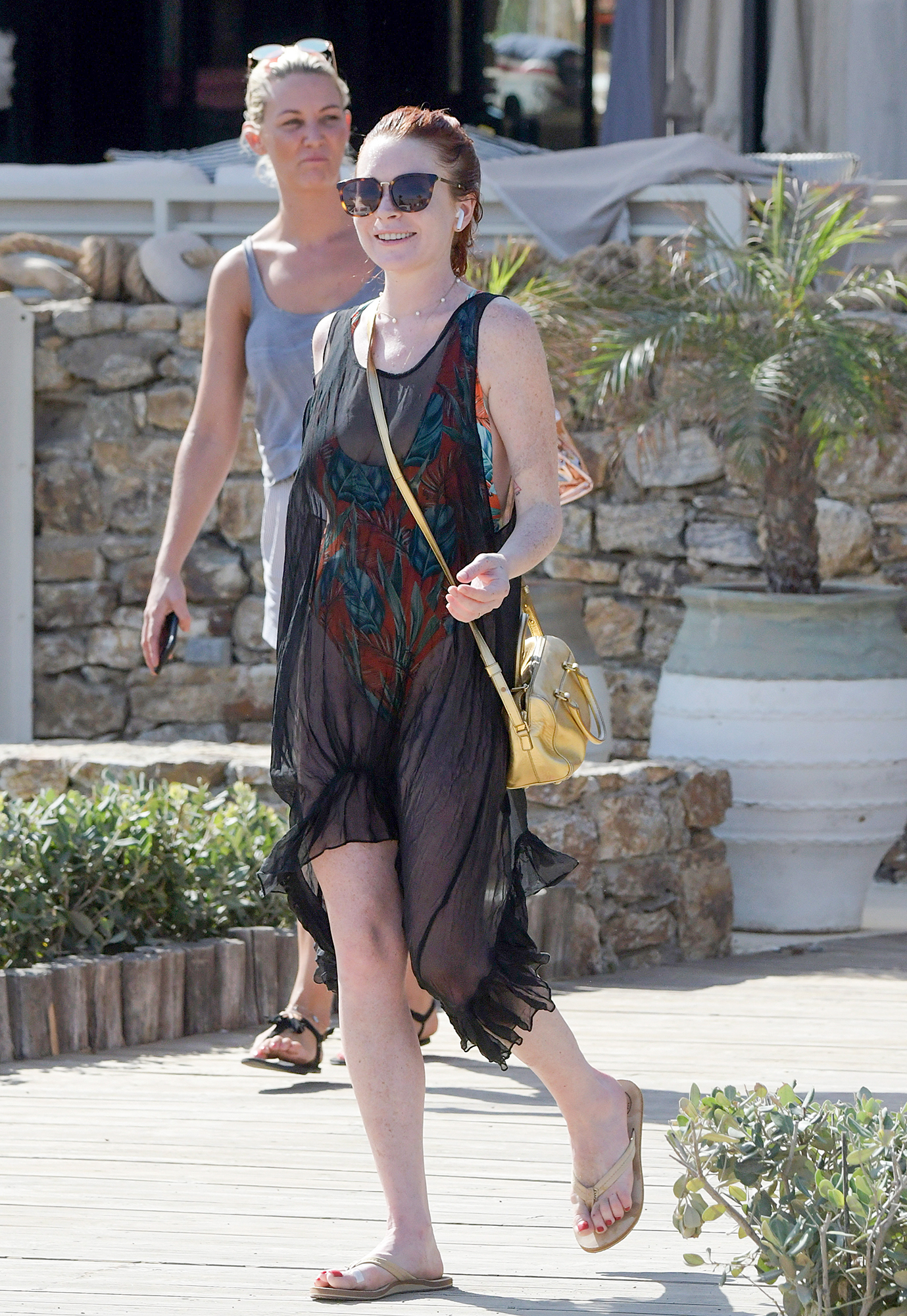Lindsay Lohan poses for swimsuit selfies outside Lohan Beach House in Mykonos