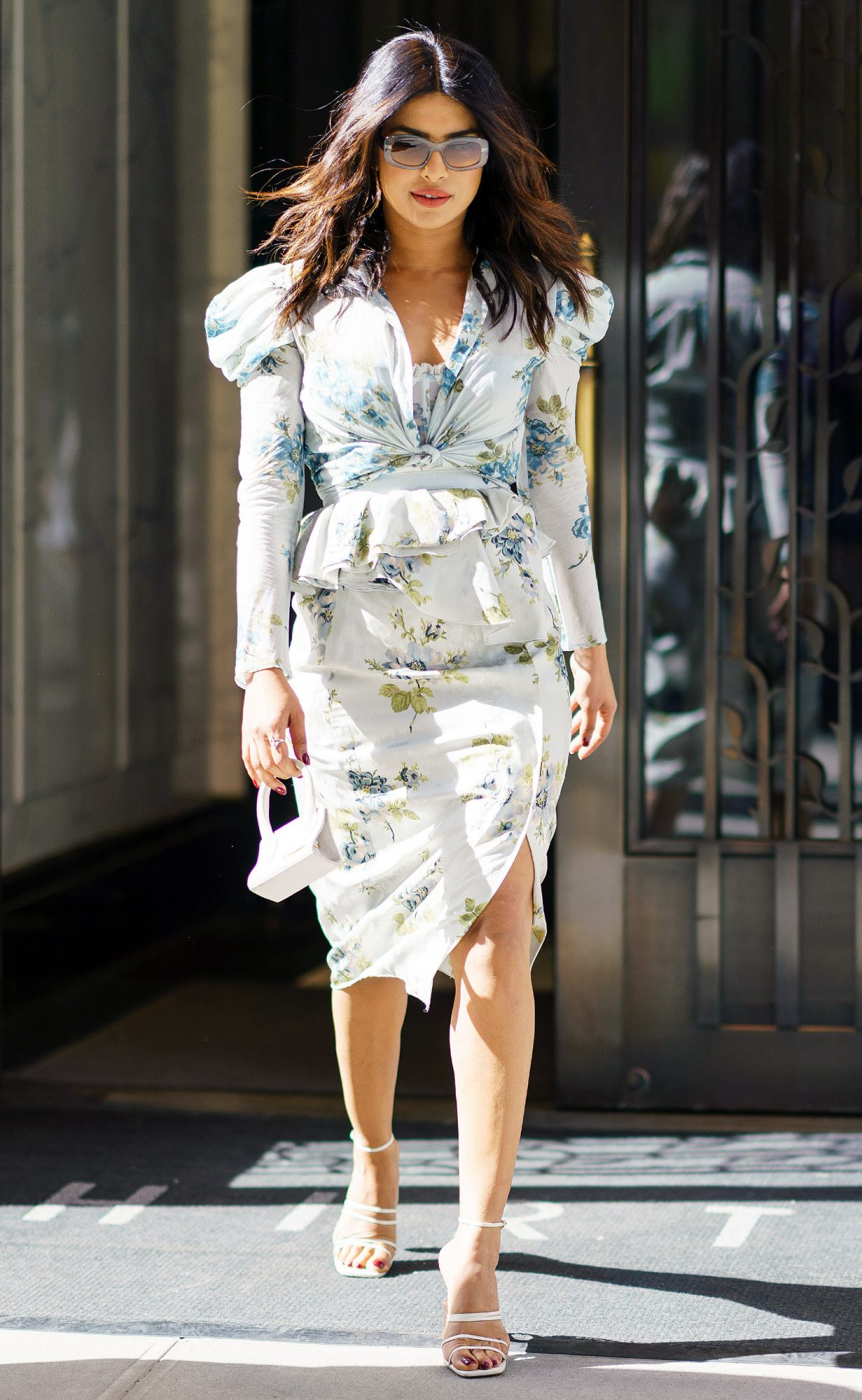 EXCLUSIVE: Priyanka Chopra wears a nice floral spring dress paired with a min tote when out and about in New York