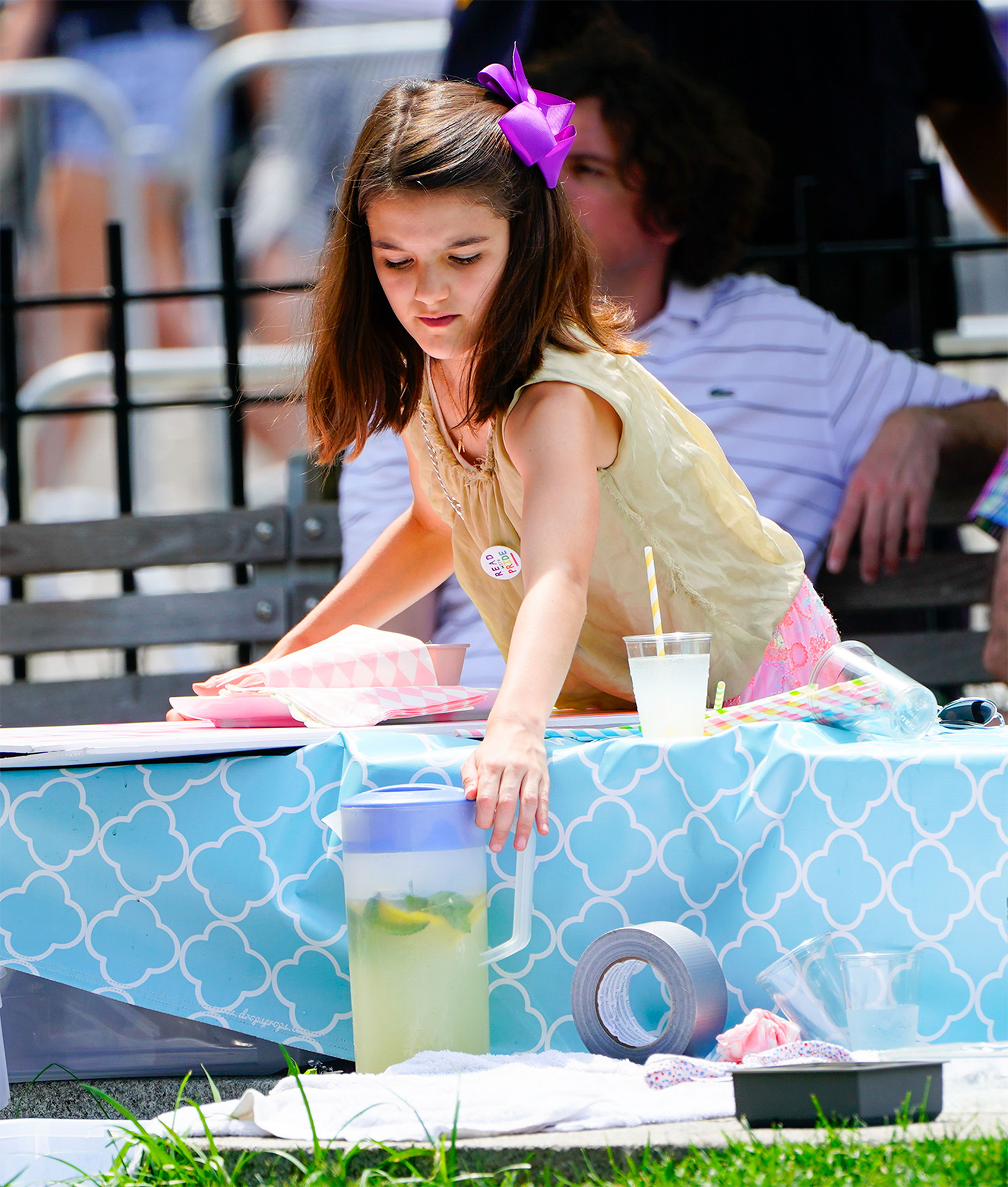 EXCLUSIVE: Suri Cruise Seen Selling Lemonade At The Annual Gay Pride Parade In New York