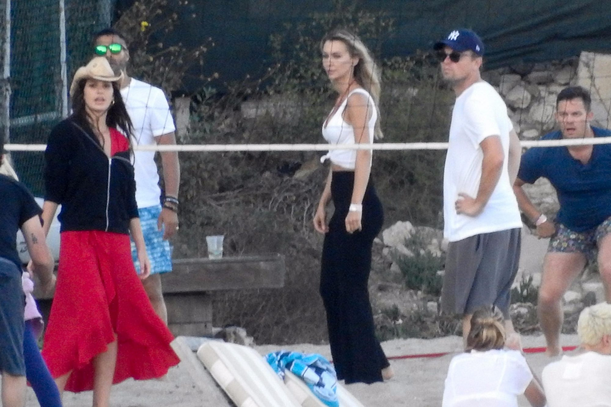 *EXCLUSIVE* Leonardo DiCaprio hangs out with Sean Penn and plays beach volleyball with sexy girls on a 4th of July party! **WEB MUST CALL FOR PRICING**