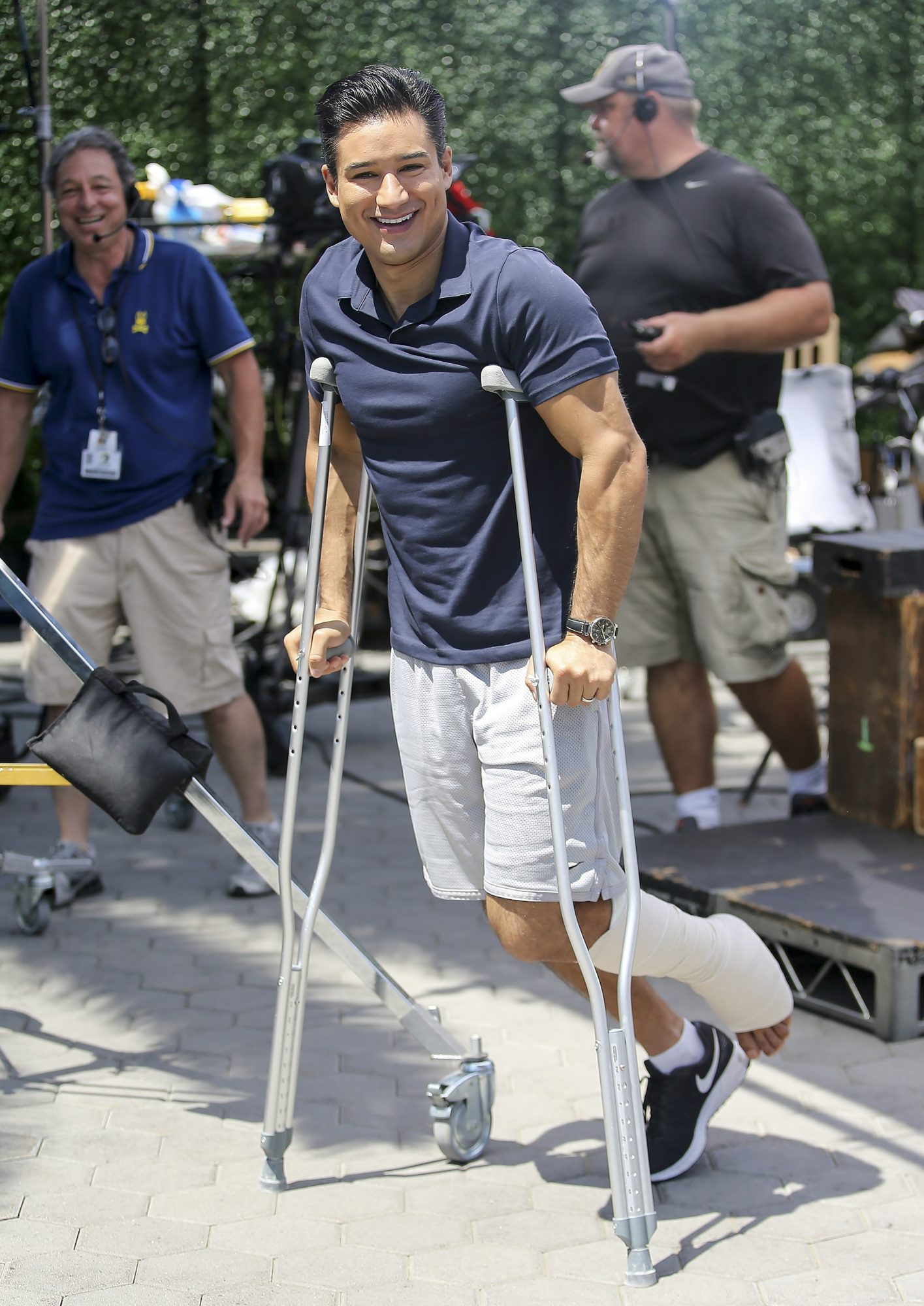 "Mario Lopez is seen wearing a leg cast on ""Extra!"" in Los Angeles, California"