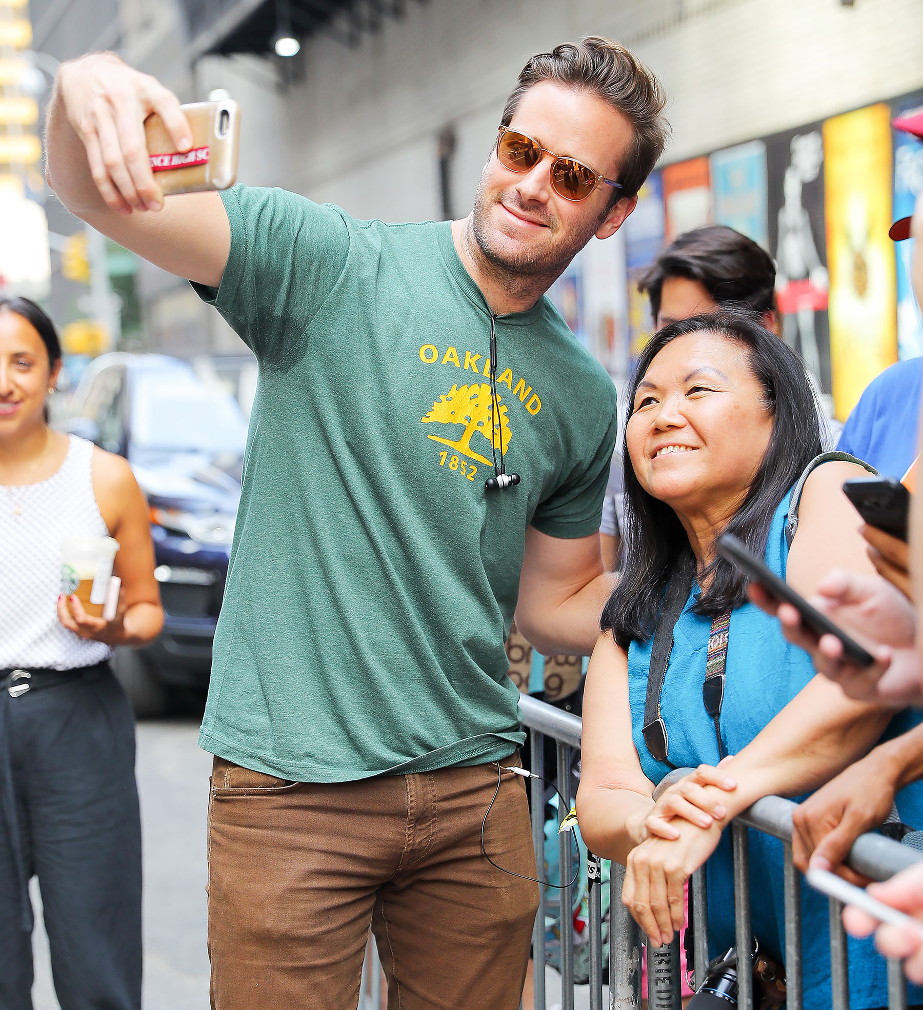 Armie Hammer is seen taking selfies with fans outside The Late Show with Stephen Colbert.