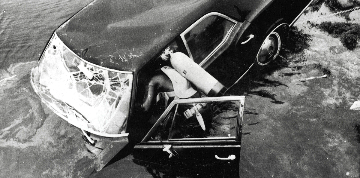 Edgartown, Massachusetts, USA, 19th July, 1969, Frogmen dive into the water as they try to raise the car belonging to Senator Edward Kennedy in which he was seriously injured and his passenger Mary Jo Kopechne was killed, Kennedy pleaded guilty to leaving