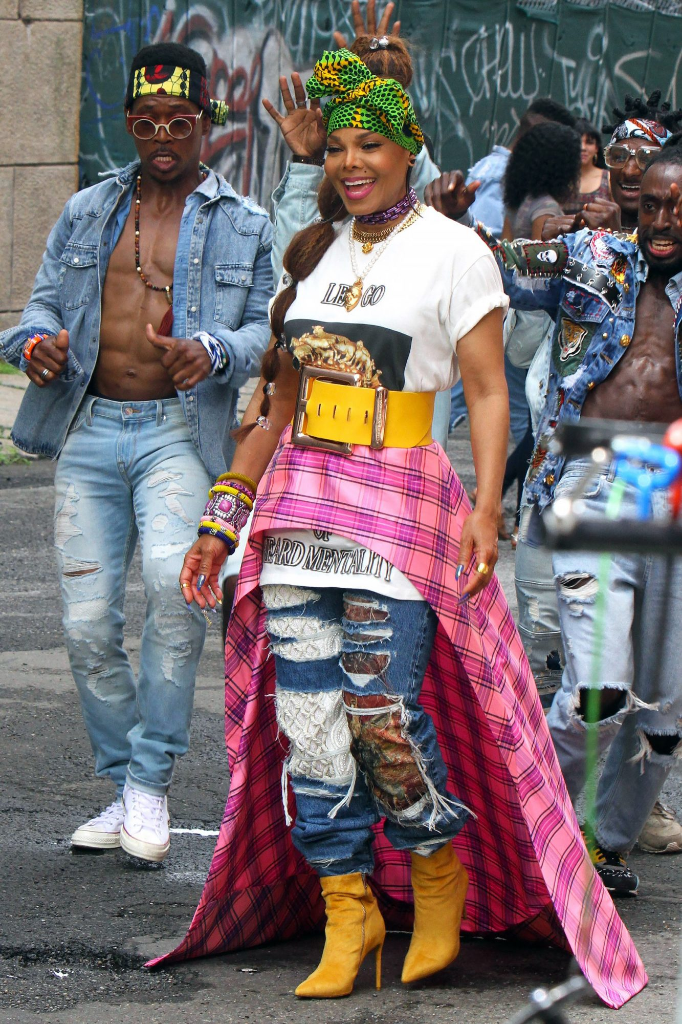 A colorfully dressed Janet Jackson dances as she films on the set of her new video 'Made for Now' in Williamsburg, Brooklyn