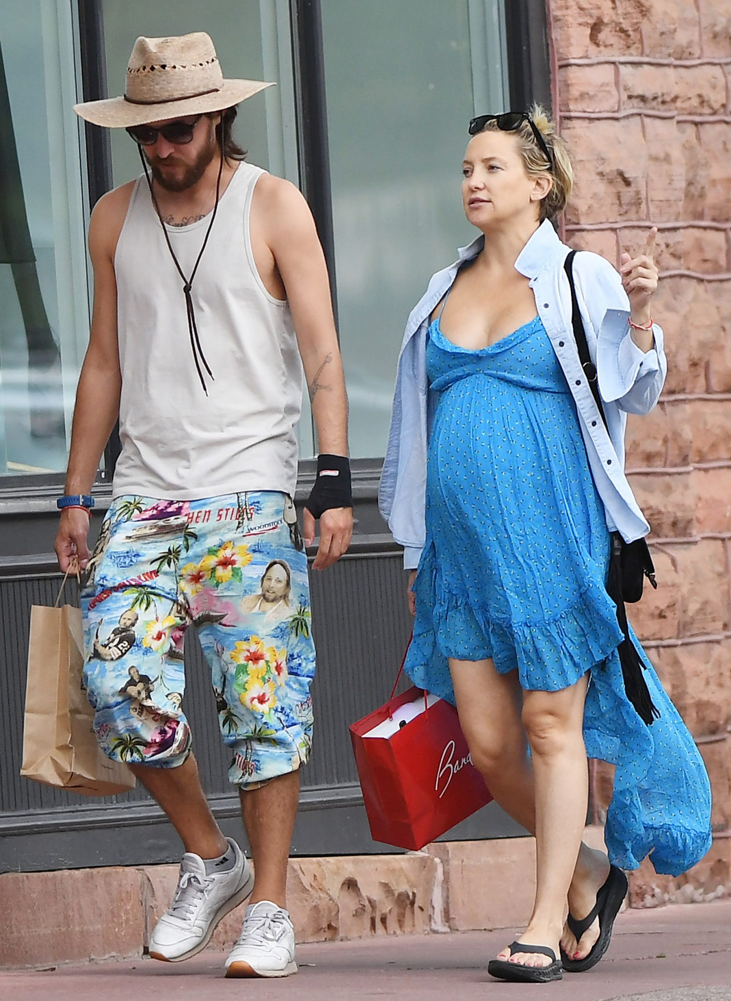 EXCLUSIVE: Kate Hudson shows off her huge baby bump while shopping in Aspen with her boyfriend Danny