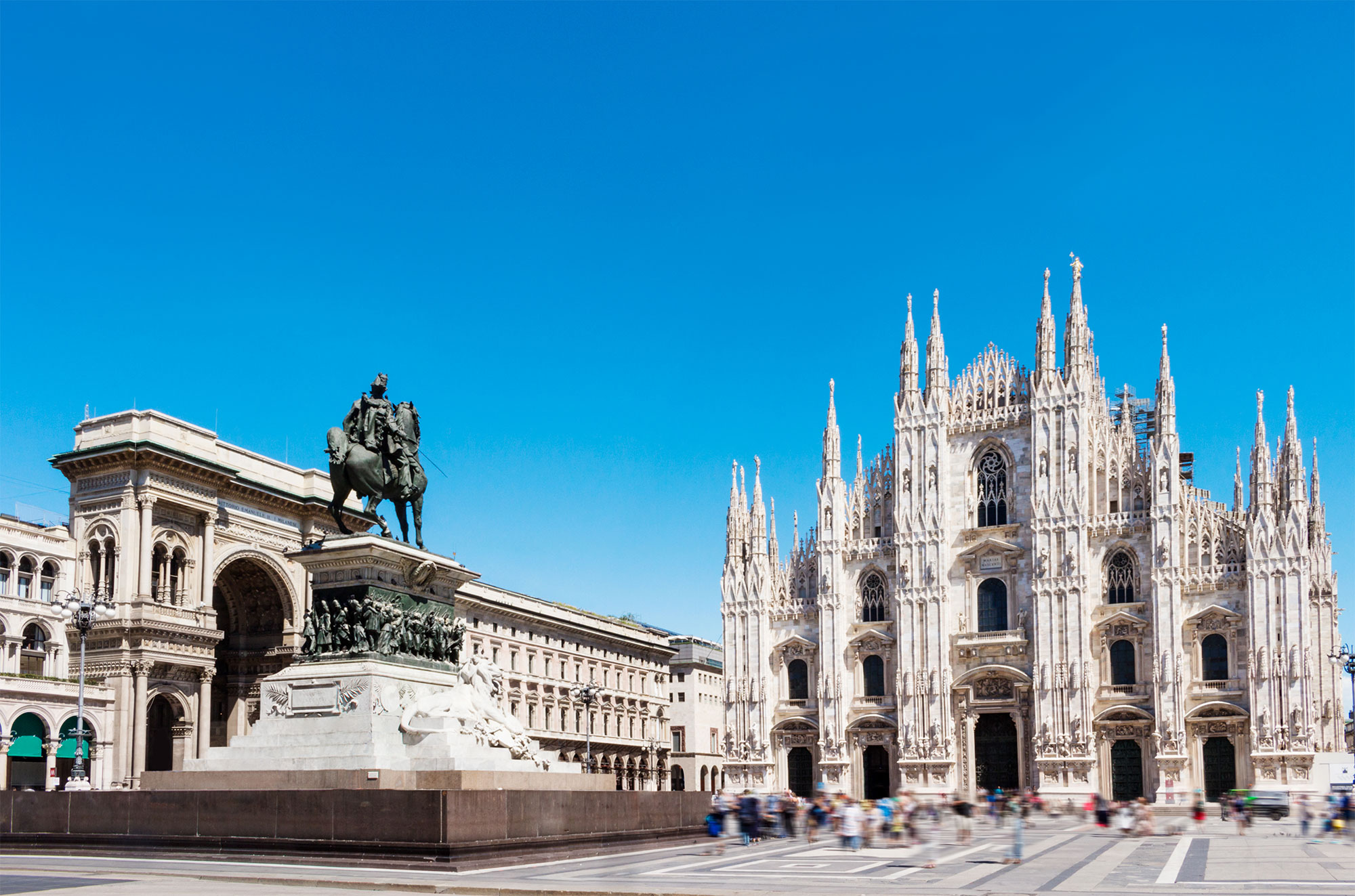 Duomo square with statue of Victor Emanuel 2nd. Milan, Italy.