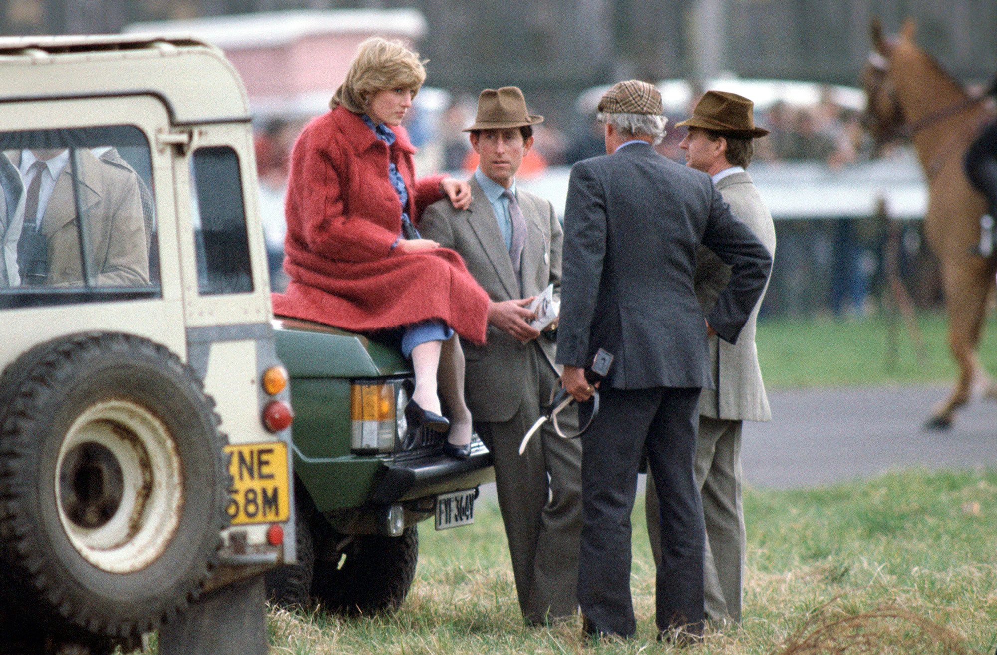 Diana Pregnant Sits On Car