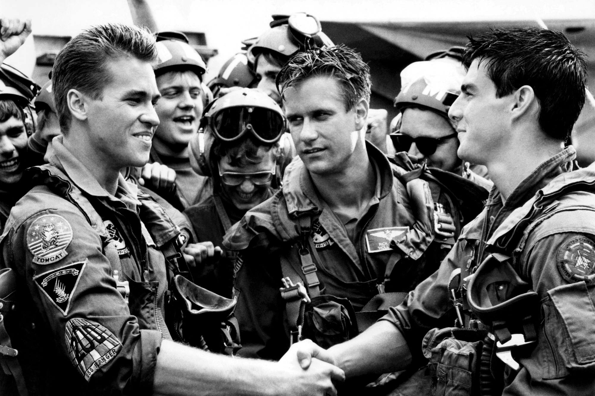 TOP GUN, from left, Val Kilmer, Barry Tubb, Tom Cruise, 1986, ©Paramount/courtesy Everett Collection