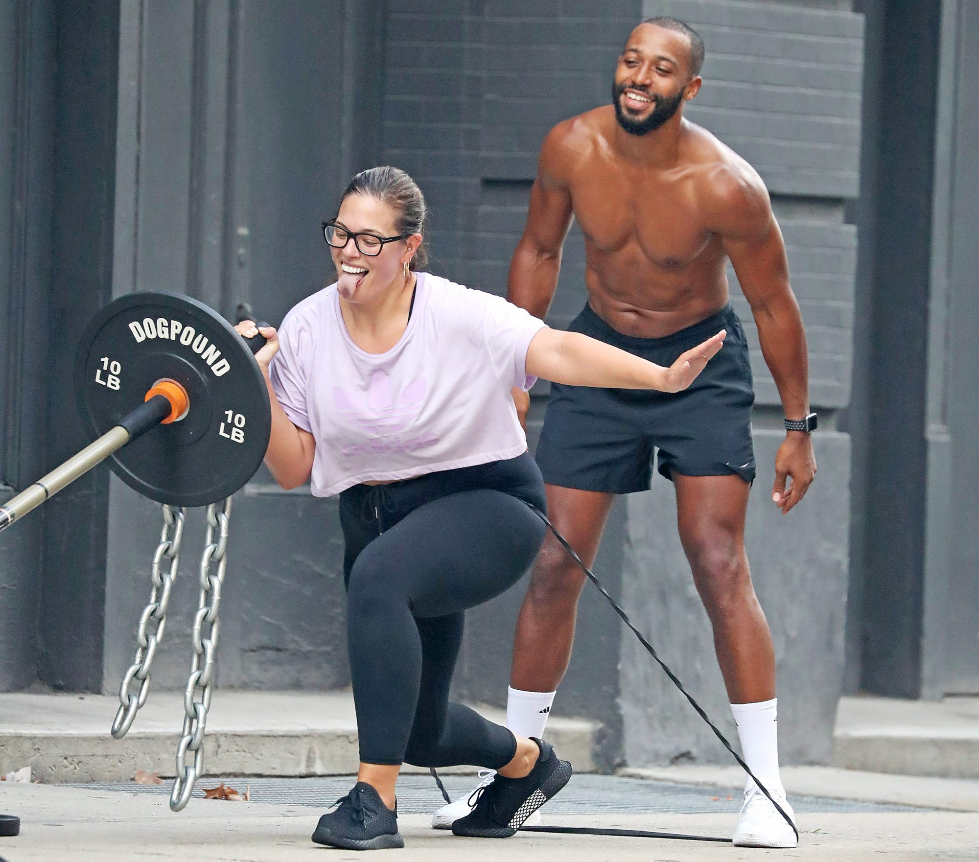 Ashley Graham and husband Justin Ervin do a workout session at Dogpound Gym, NYC
