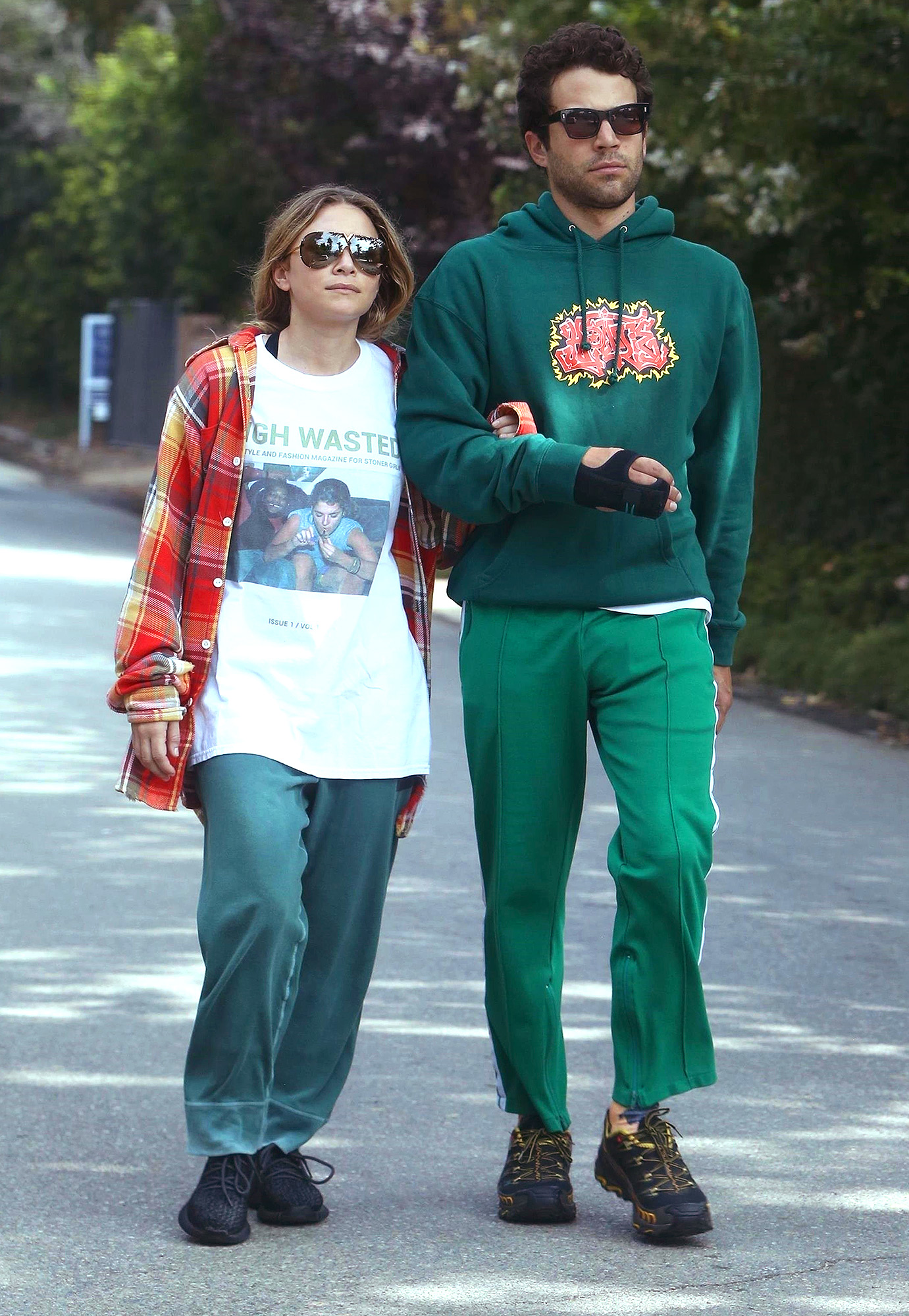 *EXCLUSIVE* Ashley Olsen clutches onto a mystery man's arm while out for a walk