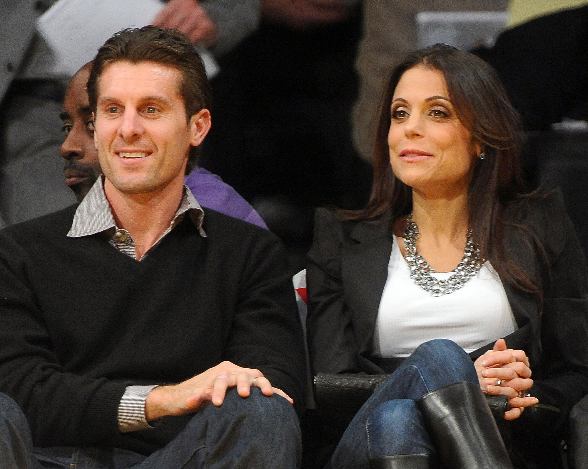 BETHENNY FRANKEL AND JASON HOPPY CUDDLING AT THE LAKERS GAME