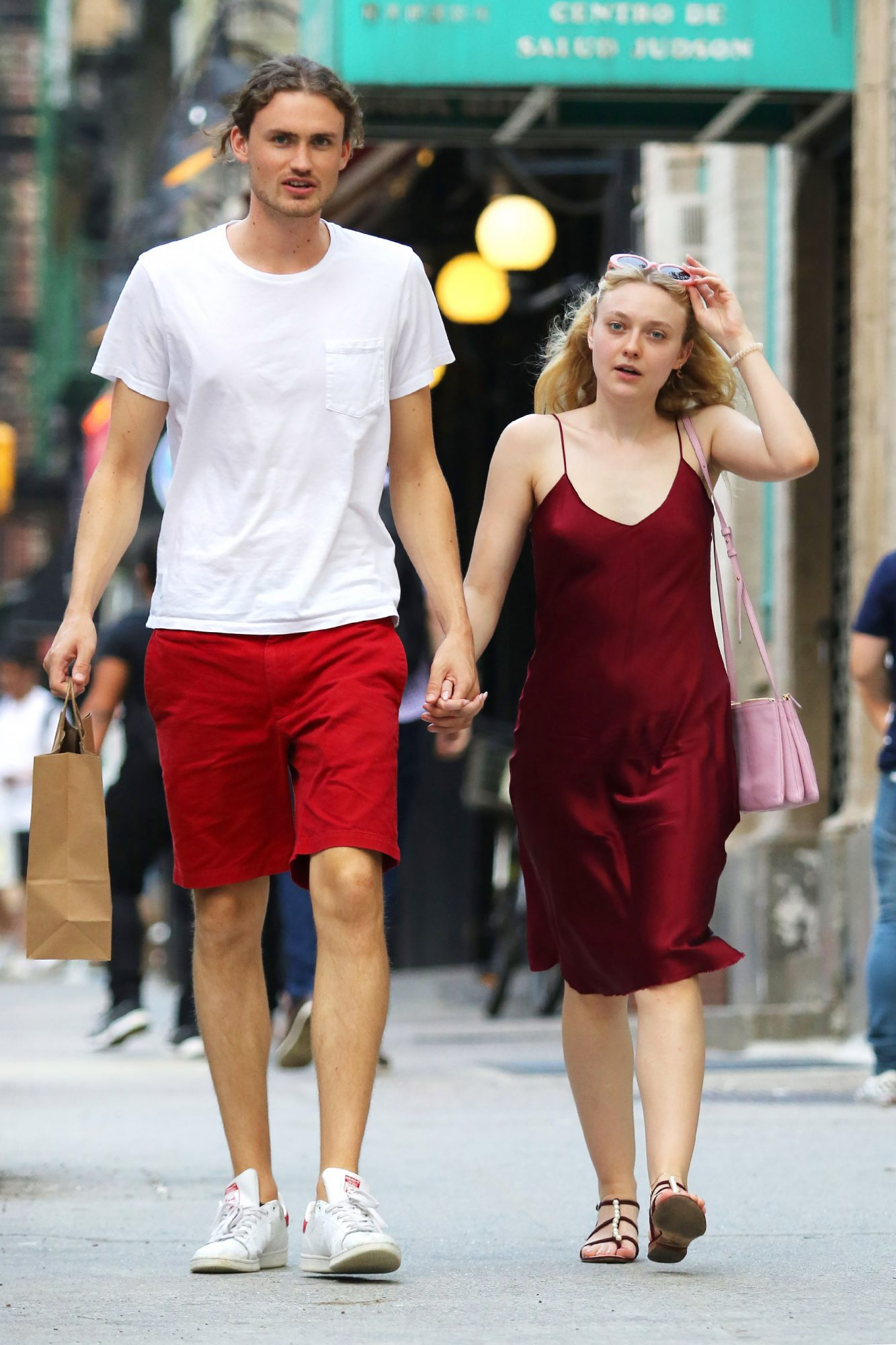 Dakota Fanning and boyfriend Henry Frye hold hands while on a romantic stroll in NYC