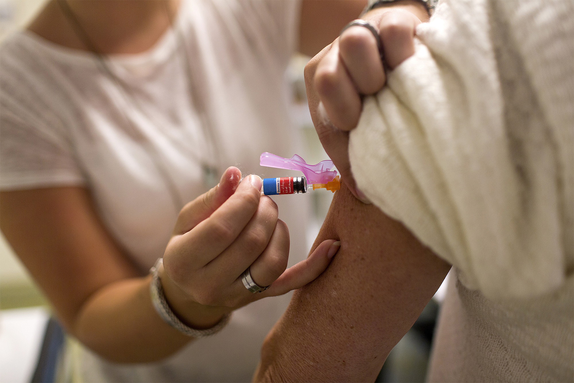 Person receiving vaccination against influenza