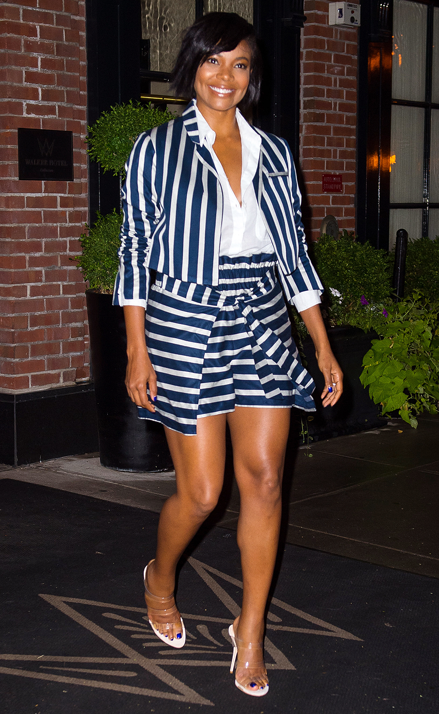 EXCLUSIVE: Gabrielle Union is all smiles as she heads out in a blue and white stripped top and skirt in New York City