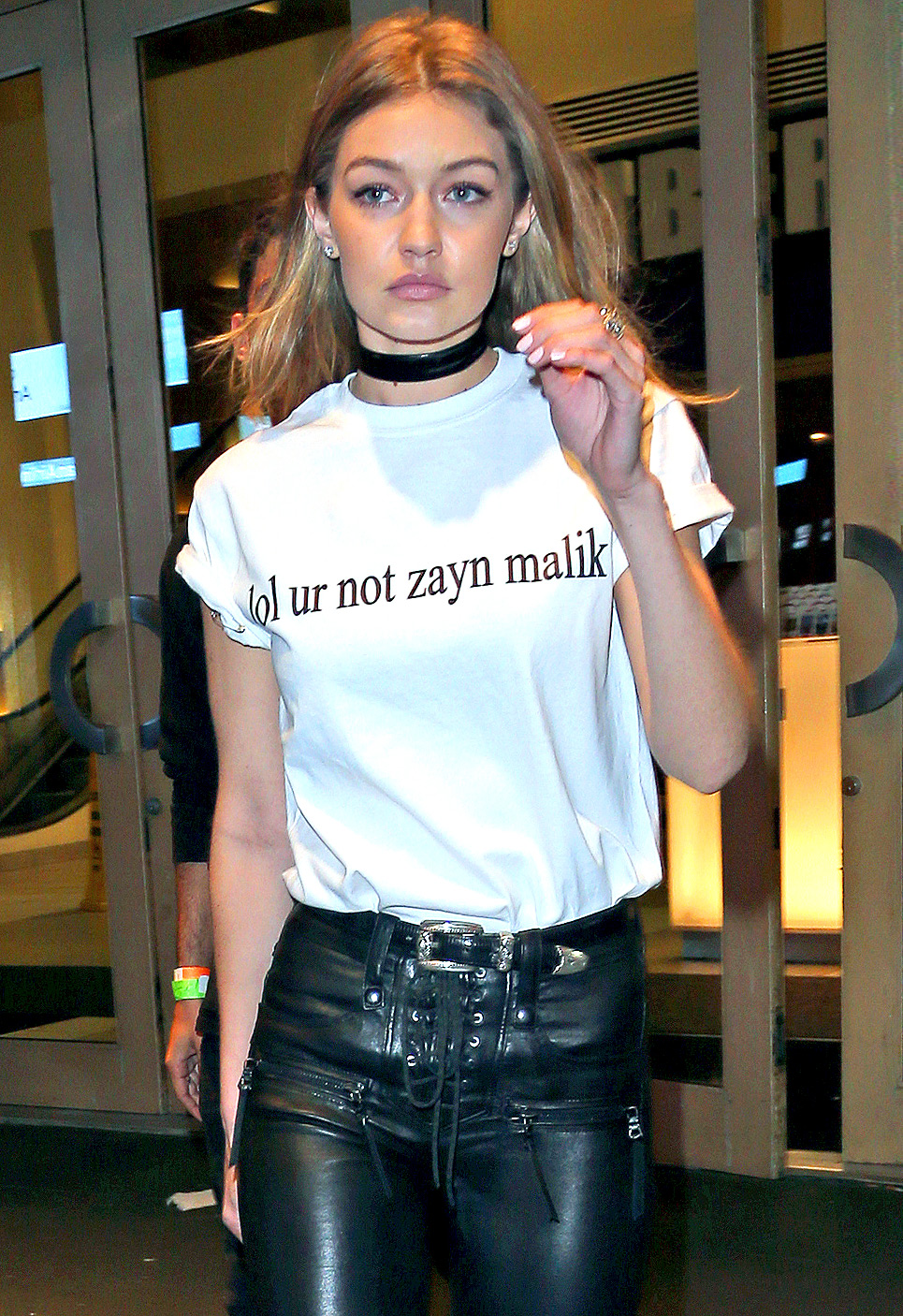 """EXCLUSIVE: Gigi Hadid pictured wearing a shirt that says """"lol Ur Not Zayn Malik"""" leaving Drakes Saturday Night Live after party at Dave and Buster's in Times Square New York City."""