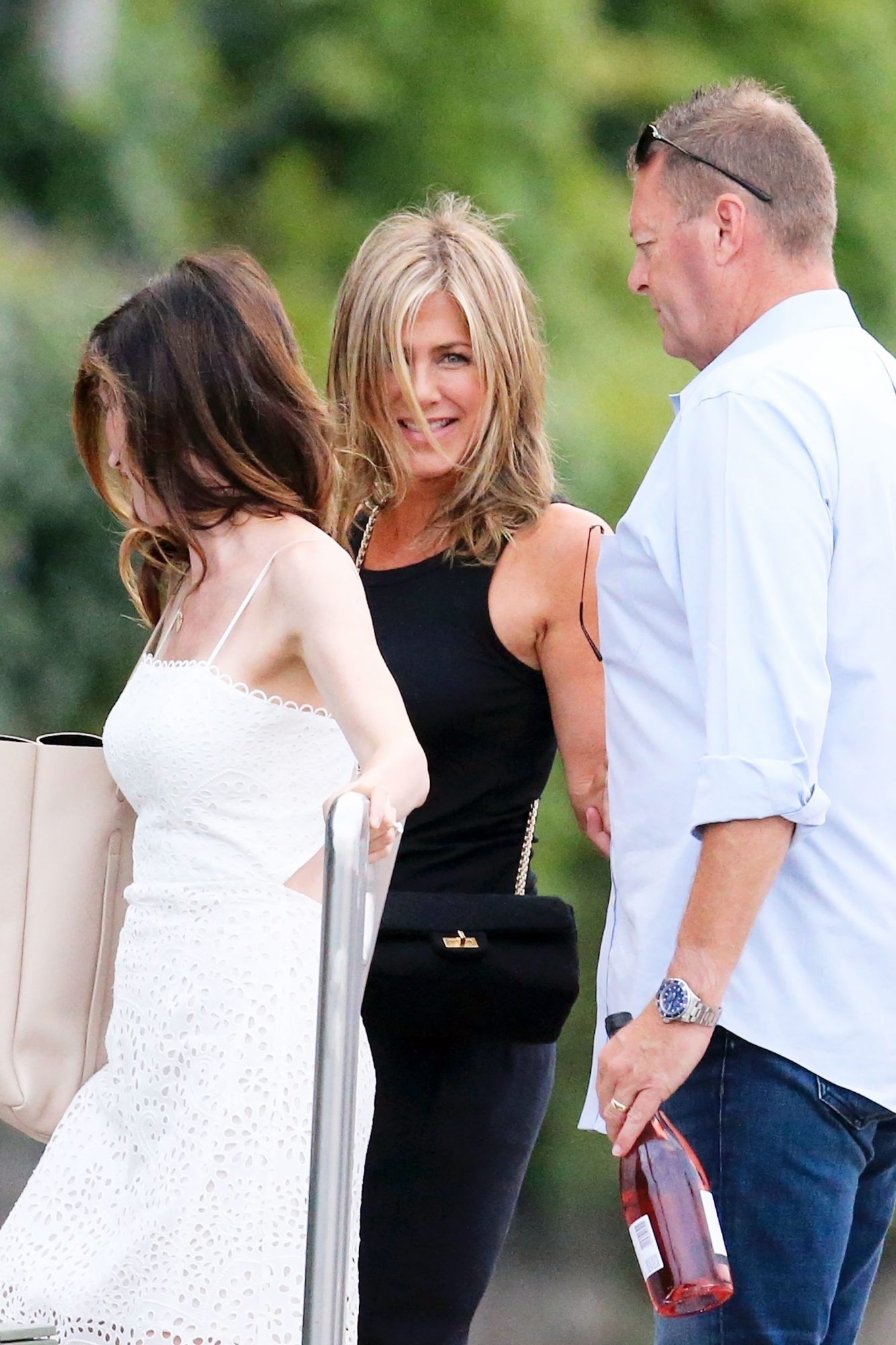 *EXCLUSIVE* Jennifer Aniston visits George Clooney with Adam Sandler and his wife Jackie **STRICT WEB EMBARGO UNTIL 3:00 PM EDT ON AUGUST 6, 2018**