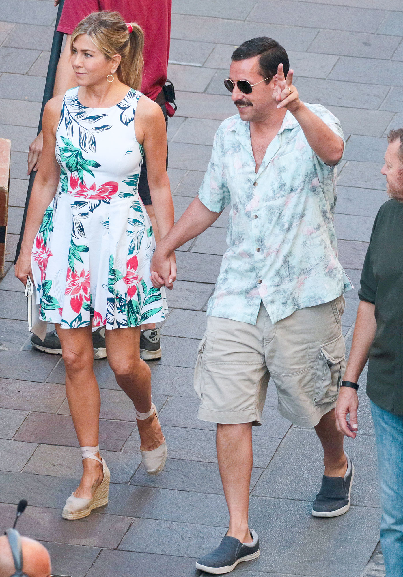 Jennifer Aniston and Adam Sandler are seen on the set of Murder Mystery in Milan, Italy.
