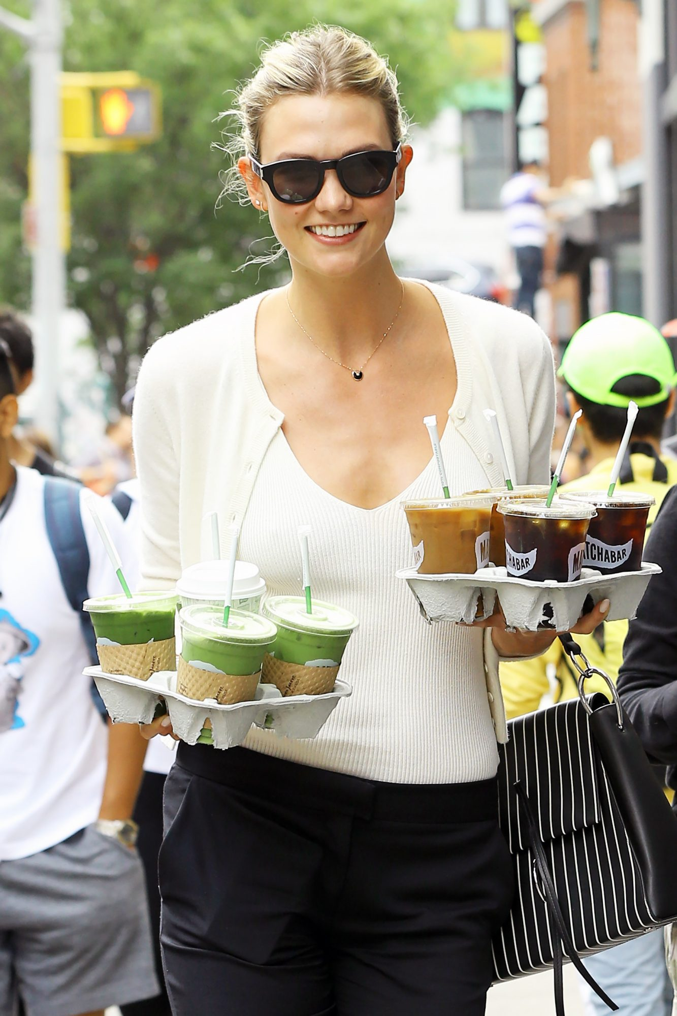 EXCLUSIVE: Model Karlie Kloss plays CEO morning 'coffee girl' carrying two trays of drinks for her Kode With Klossy staff in NYC