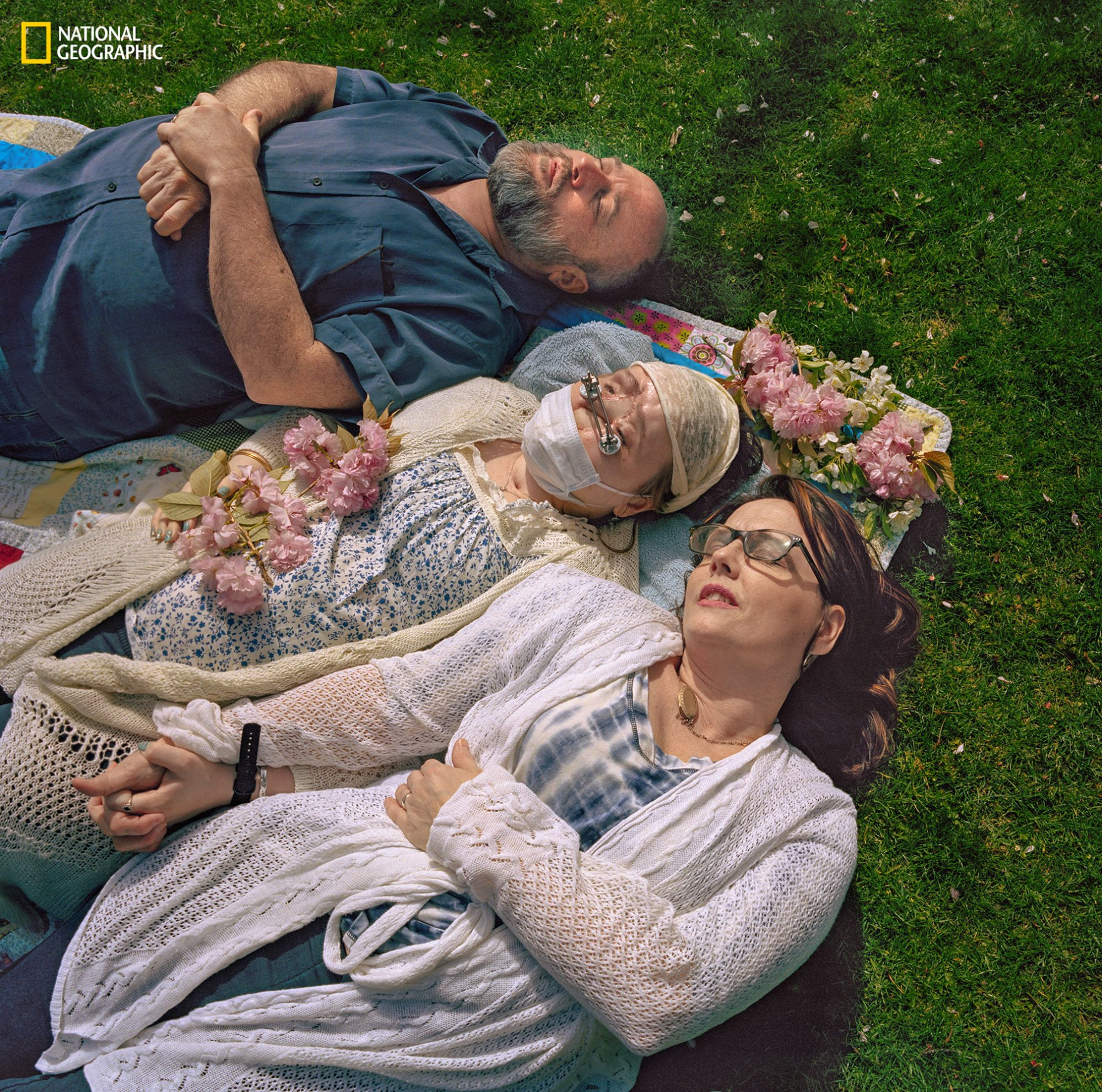 003Photograph by Maggie Steber/National Geographic1 year, 1 day before Katie's transplantTaking advantage of a sunny spring day, Katie and her parents, Robb and Alesia Stubblefield, indulge in a nap in a park near the Cleveland Clinic. With Katie in