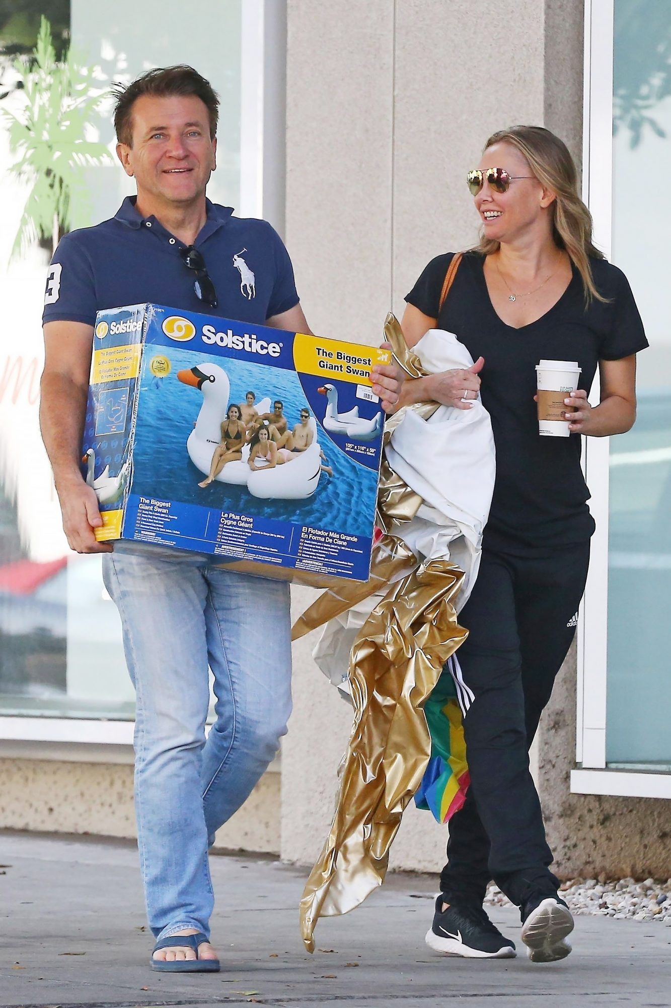 *EXCLUSIVE* Kym Johnson and Robert Herjavec shop for pool floats at Kitson