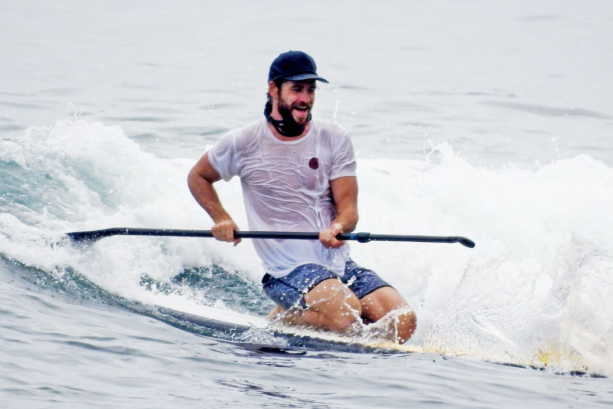 *EXCLUSIVE* Liam Hemsworth enjoys his Tuesday afternoon paddle boarding with friends