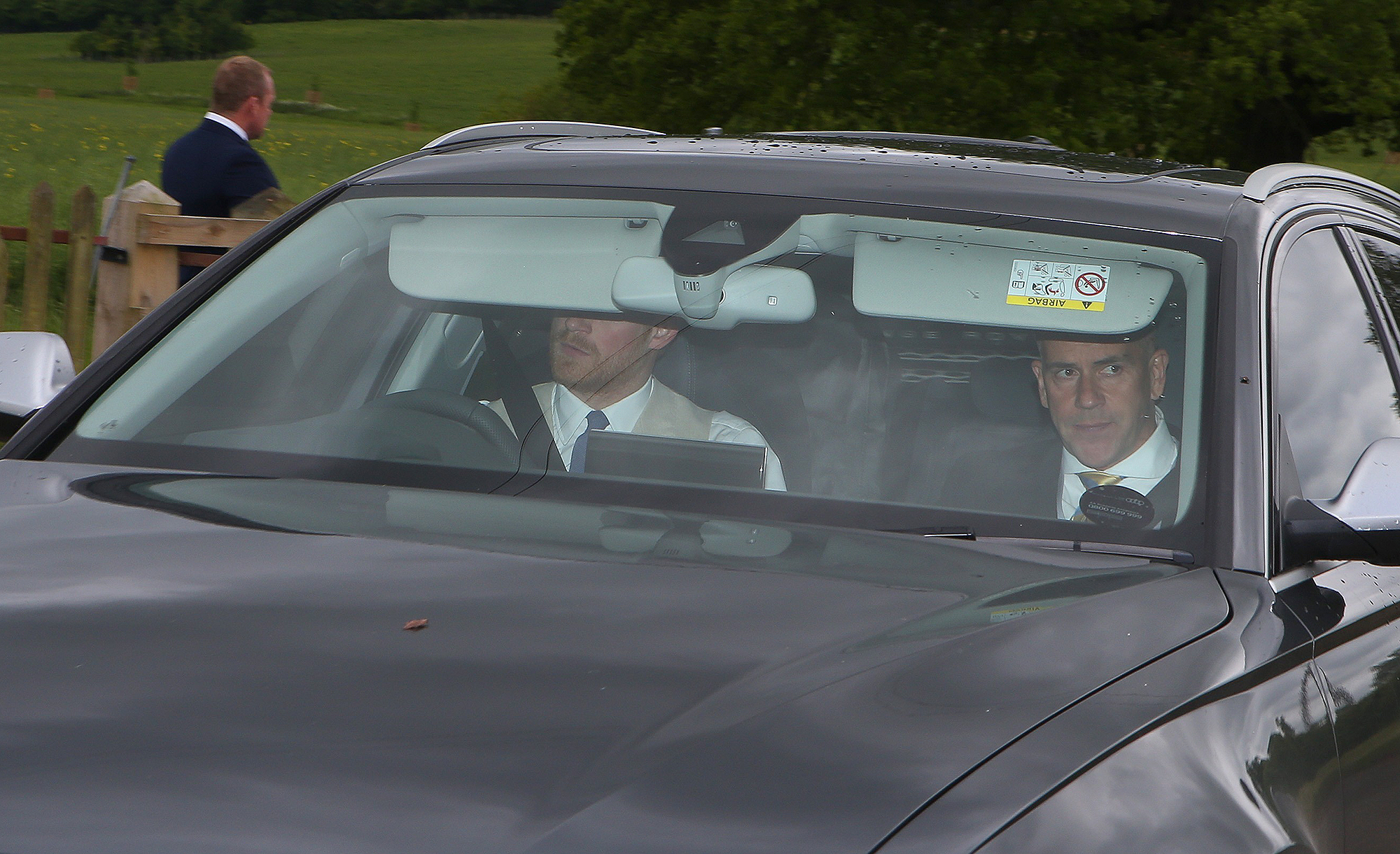 HRH Prince Harry seen leaving the Pippa Middleton and James Matthews wedding early to collect girlfriend Meghan from Kensington Palace