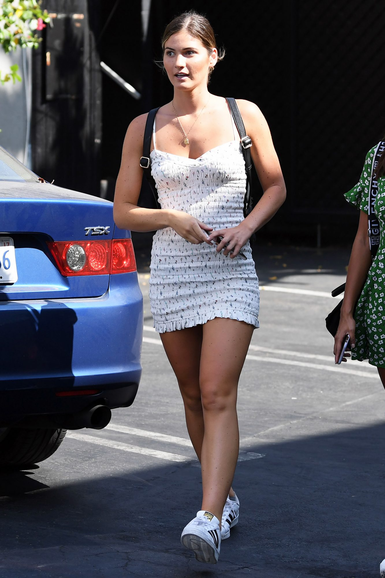 Shauna Sexton steps out for lunch in a summer dress with another palyboy model