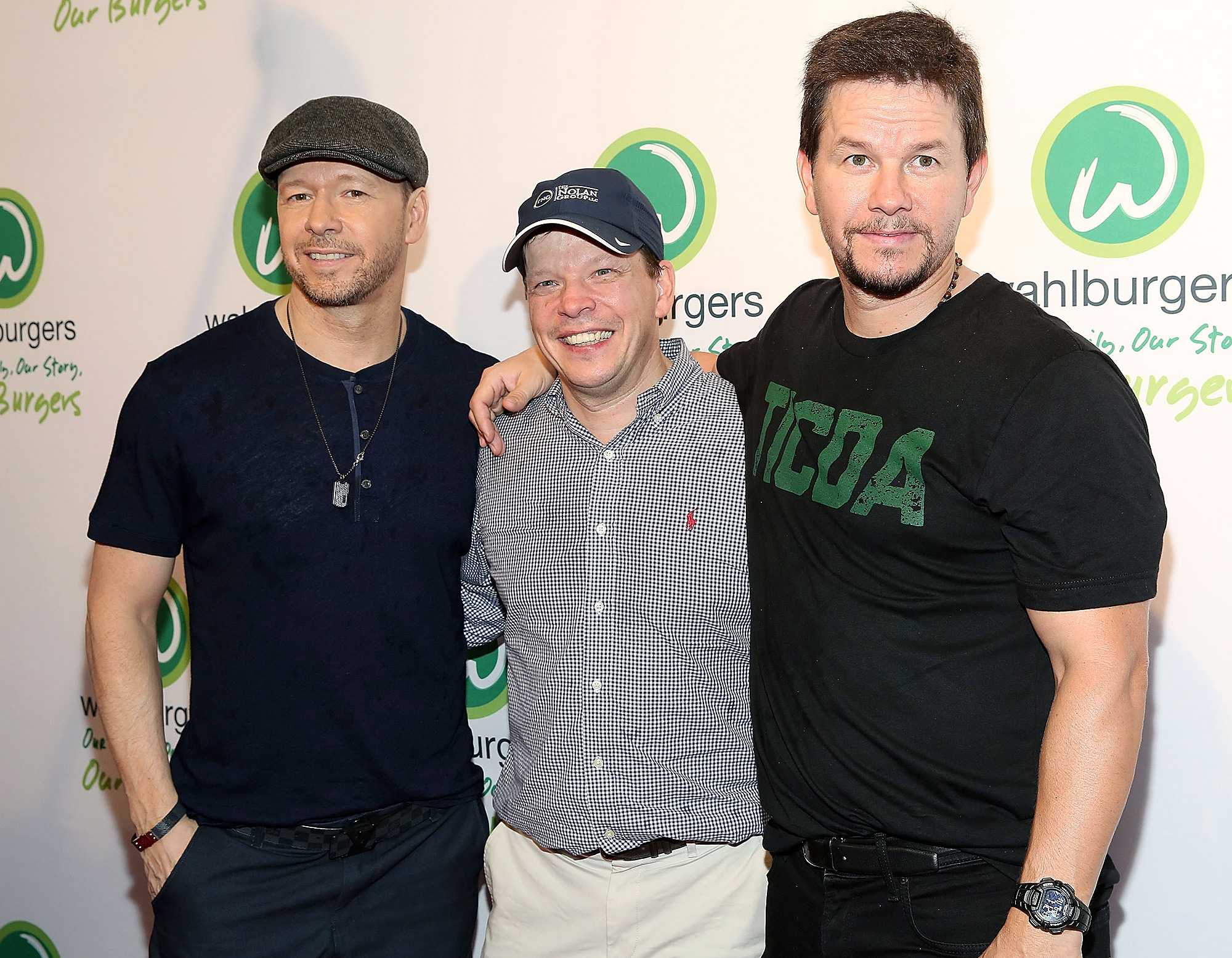 NEW YORK, NY - JUNE 23: (L-R) Donnie Wahlberg, Paul Wahlberg and Mark Wahlberg attend the Wahlburgers Coney Island VIP Preview Party at Wahlburgers Coney Island on June 23, 2015 in New York City. (Photo by Mireya Acierto/FilmMagic)