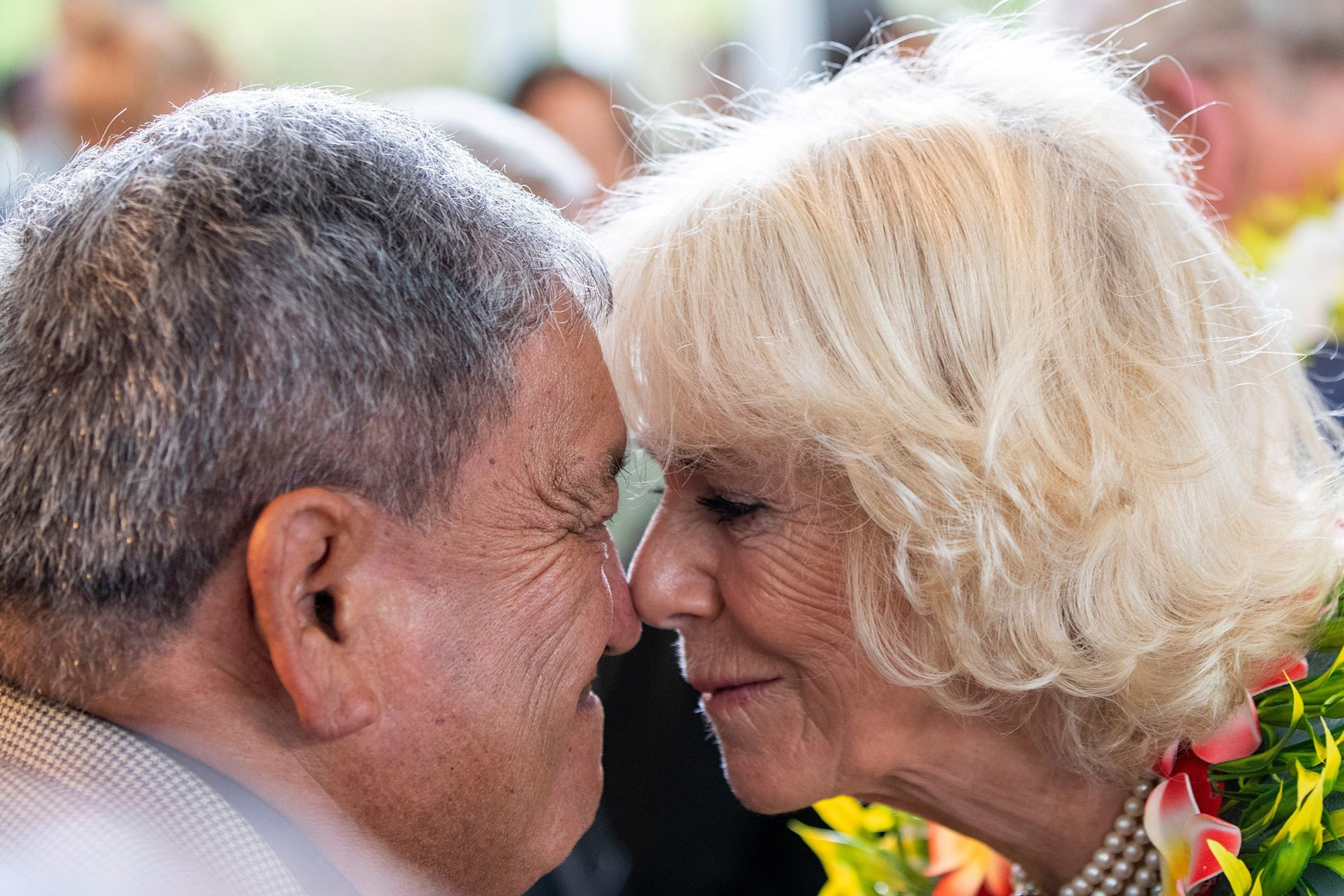Britain's Camilla, Duchess of Cornwall receives a hongi, a traditional welcome from an Elder as she and Prince Charles, Prince of Wales visit the Wesley Community Centre in Auckland on November 18, 2019. - The Prince of Wales and Duchess of Cornwall are on an eight-day tour of New Zealand.