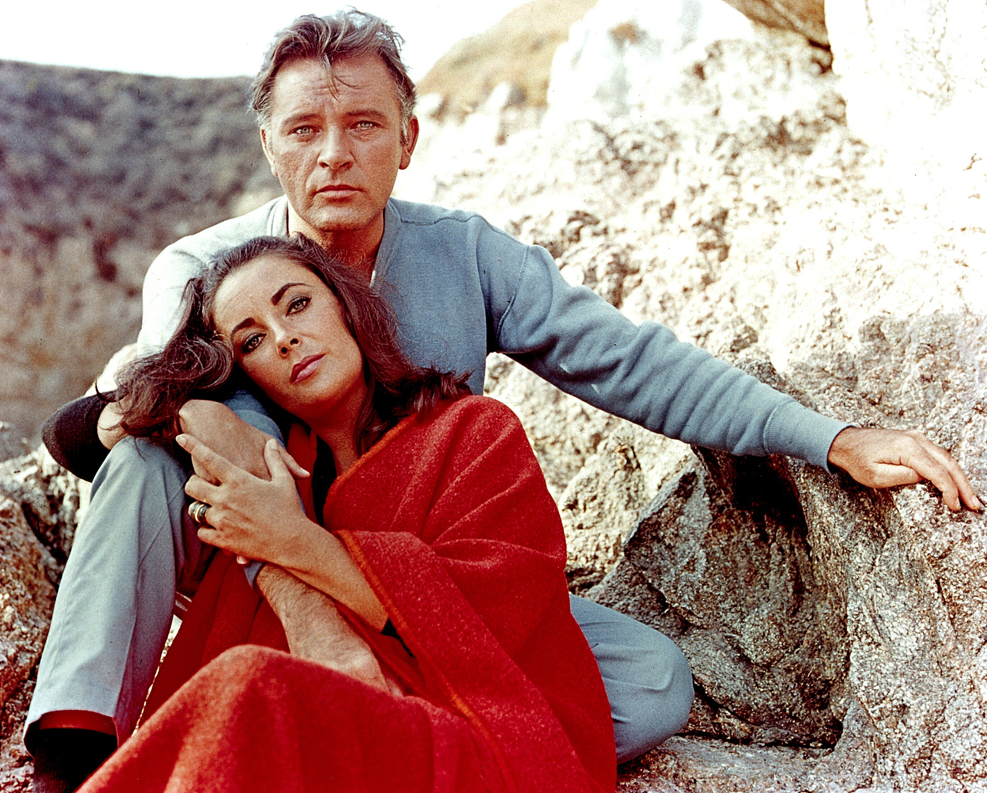 "Elizabeth Taylor and Richard Burton on the film set of ""The Sandpiper"""