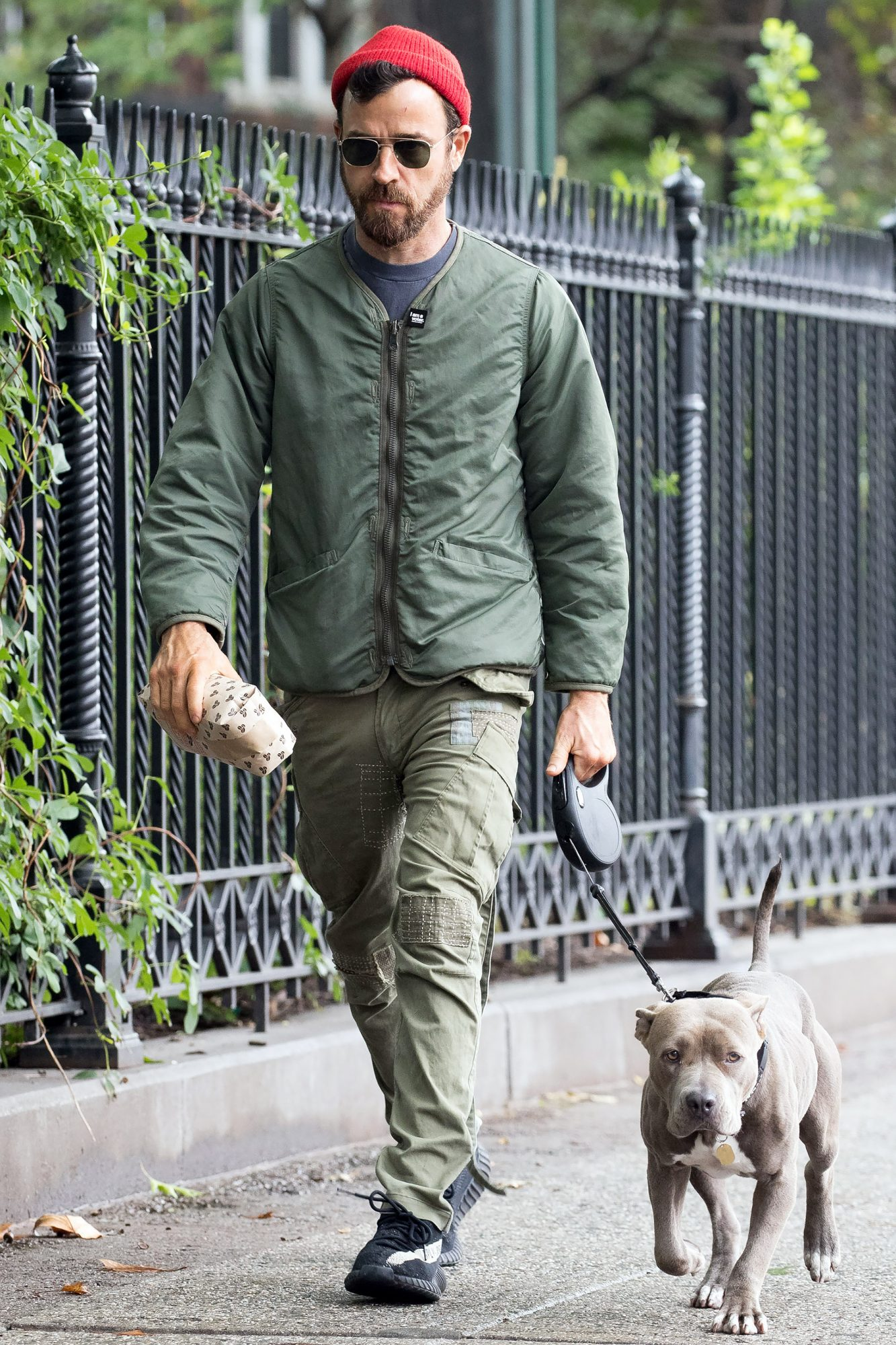 EXCLUSIVE: Justin Theroux seen picking up a coffee bag from a local grocery store while walking his dog in New York City
