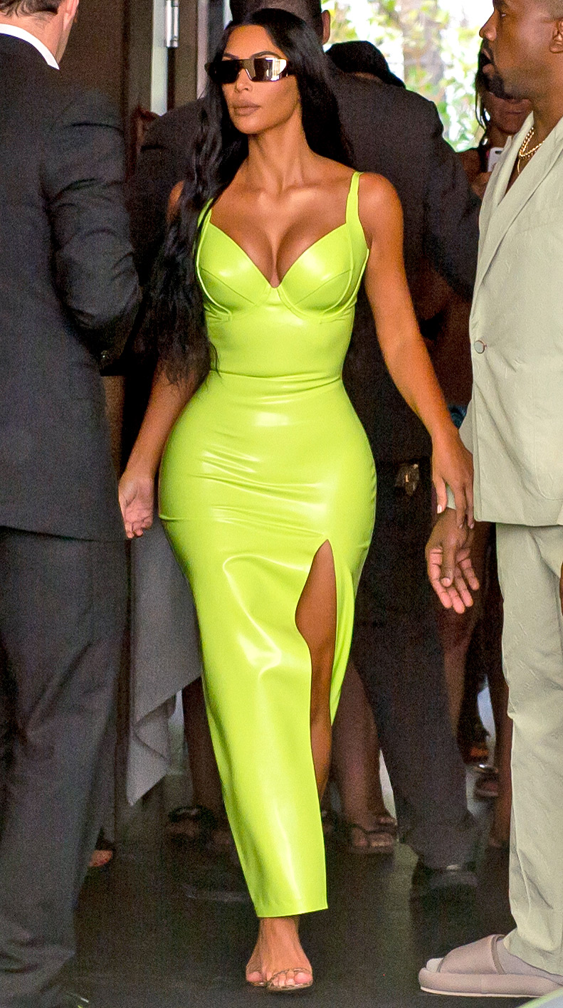 Kim Kardashian shined extra bright in neon and she and Kanye West arrive at Miami's Versace Mansion for rapper 2Chainz Wedding on Saturday (aug 18).