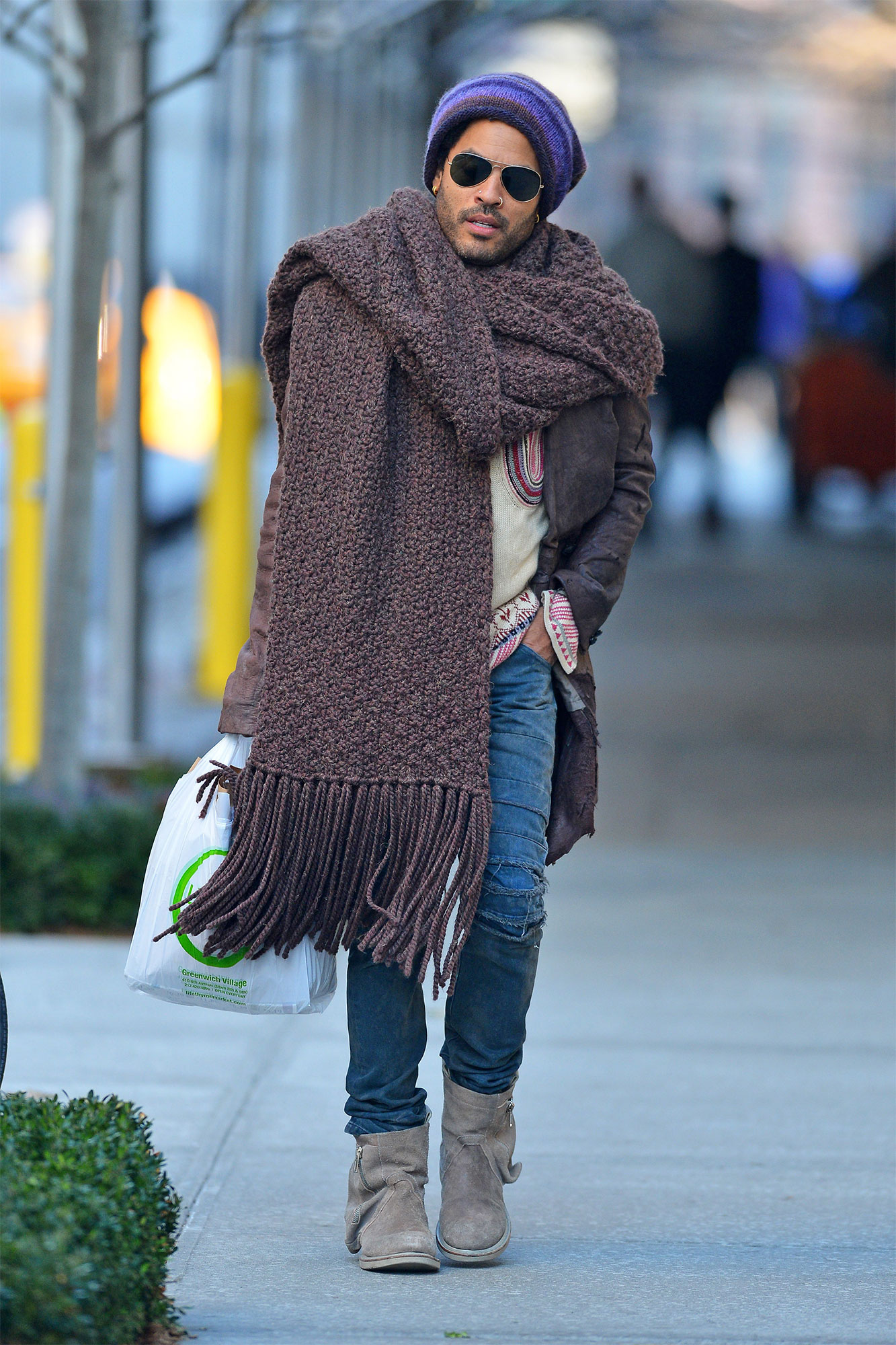 Lenny Kravitz fights the winter chill with a giant scarf and knit hat, as he goes out and about in New York City