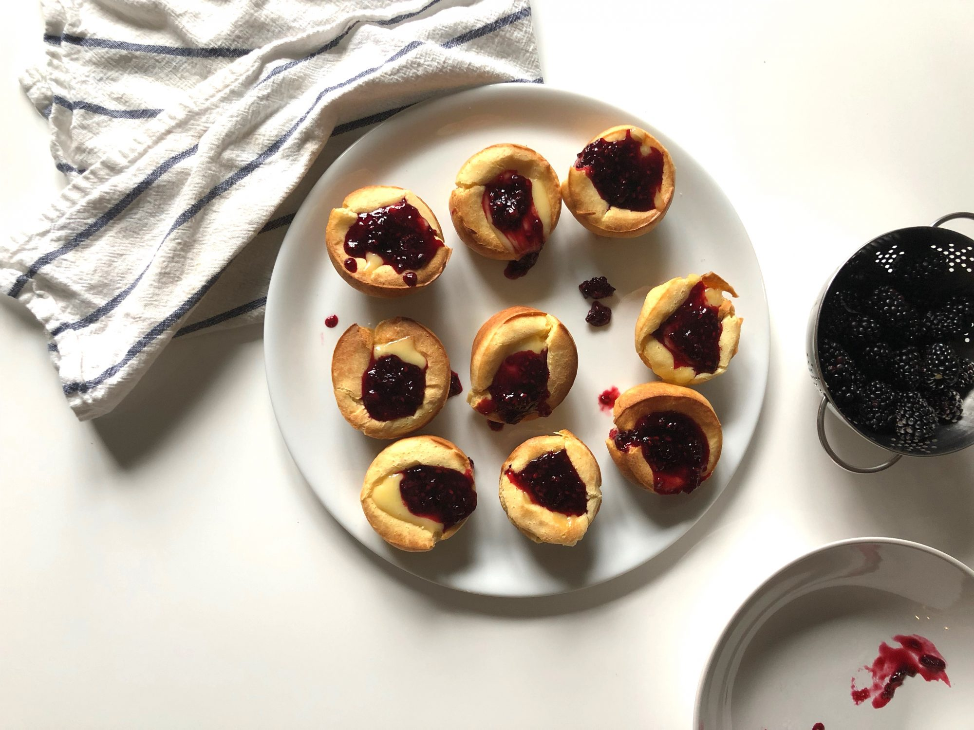 Chrissy Teigen's Fluffy Popovers with Brie and Blackberry Jam