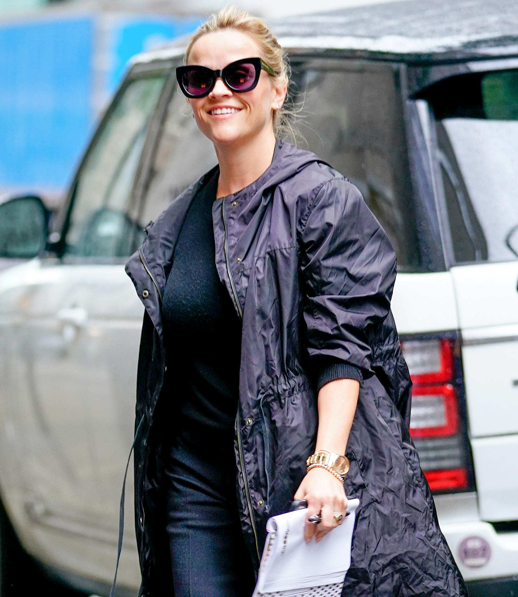 Reese Witherspoon out and about in the Rain in New York