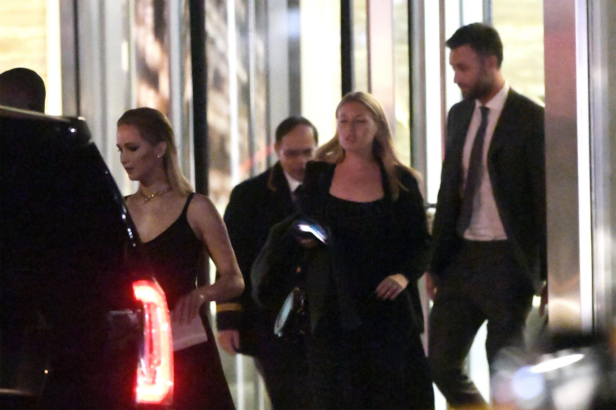 Jennifer Lawrence photographed leaving her apartment tonight with her boyfriend Cooke on their way to an event