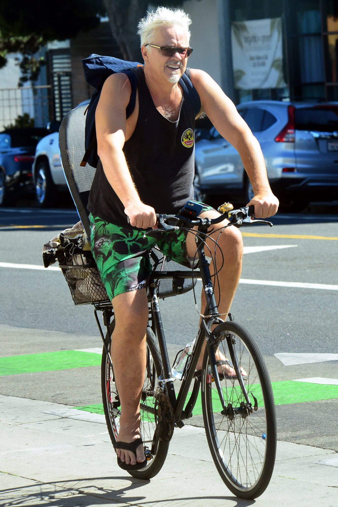 EXCLUSIVE: Tim Robbins embraces the sunny beach life style as he is spotted riding his bike on his way to go Boogie boarding in Santa Monica, Ca