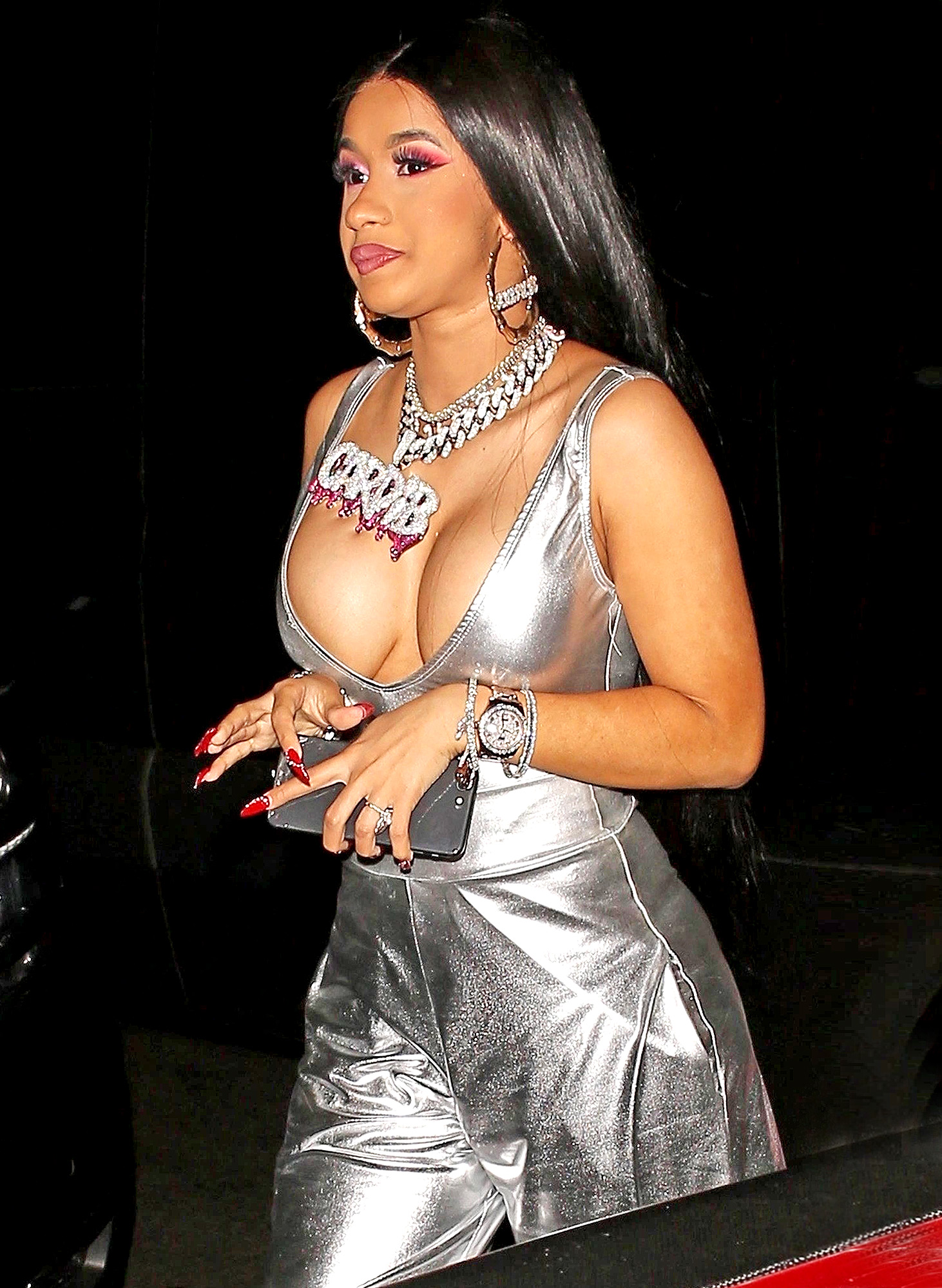 Cardi B shows of her cleavage silver leaving the Argyle nightclub with Offset