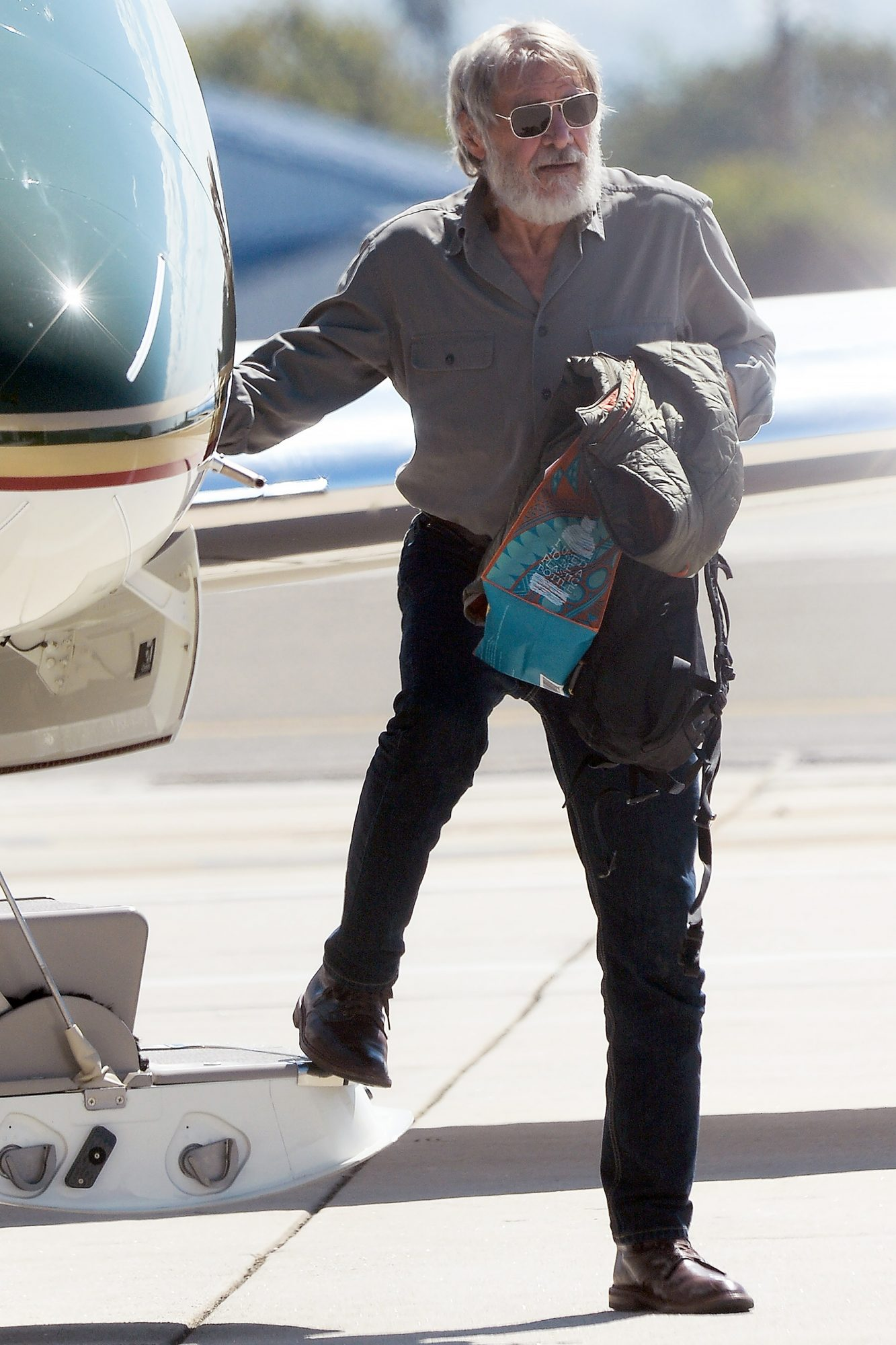 EXCLUSIVE: Harrison Ford Shows off His Bushy Beard as He Arrives in Los Angeles in a Private Jet that he Piloted.