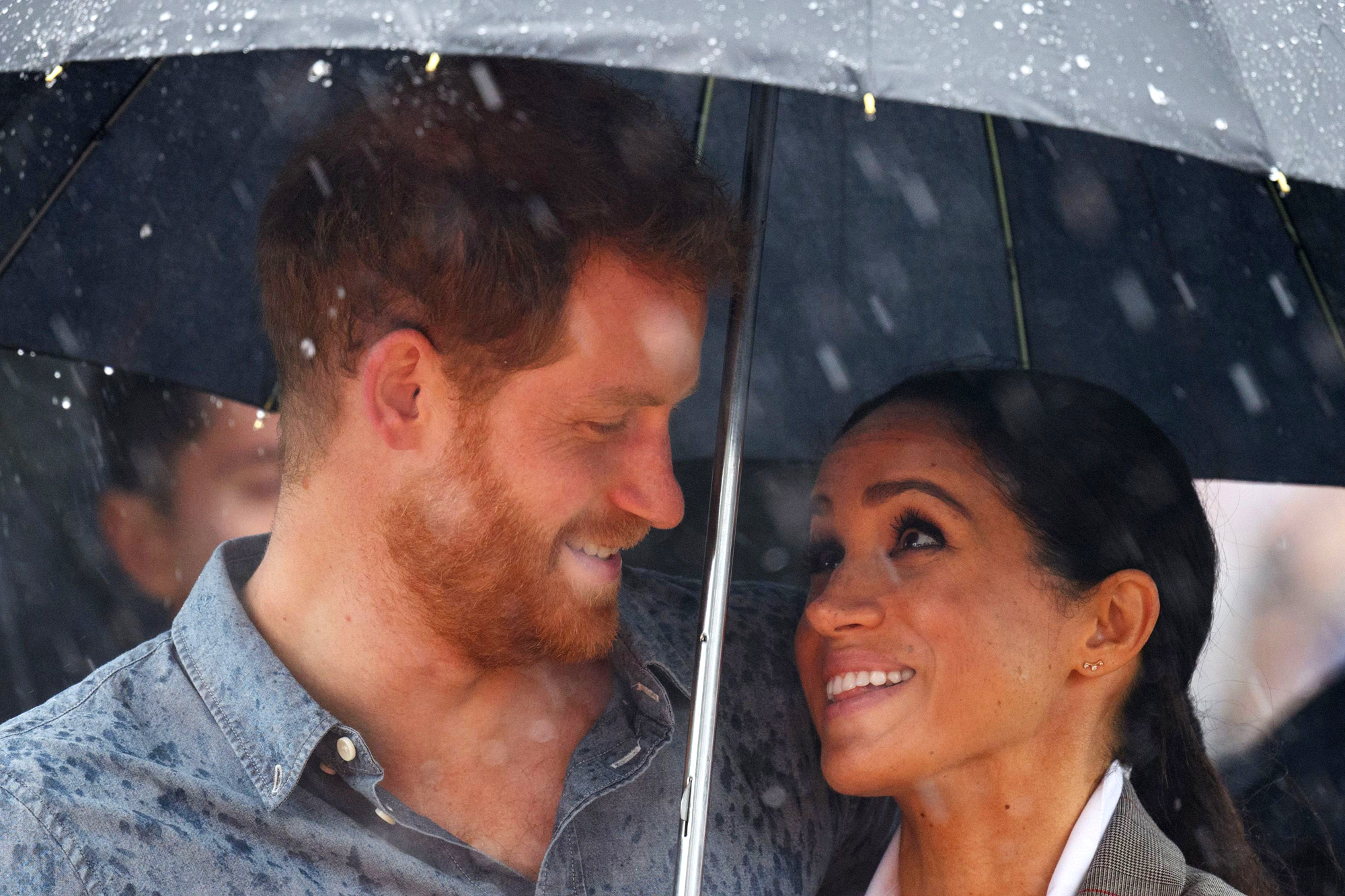 royal miracle rain falls on prince harry and meghan markle s tour people com https people com royals rain falls prince harry meghan markle tour after visiting drought stricken farm