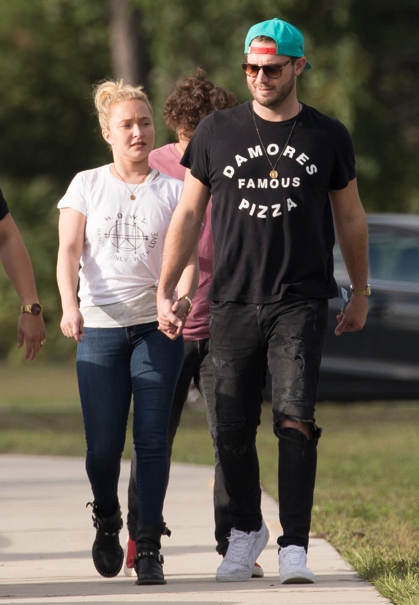 Hayden Panettiere holds hands with boyfriend Brian Hickerson as she visits family in Florida.