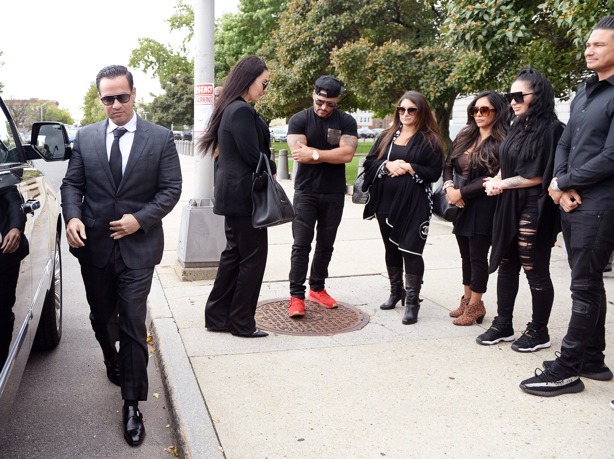 Mike (The Situation) Sorrentino and his girlfriend are photogaphed arriving at Newwark Nj court were he is to be sentenced for tax evasion, All Jersey shore members showed up to support him also