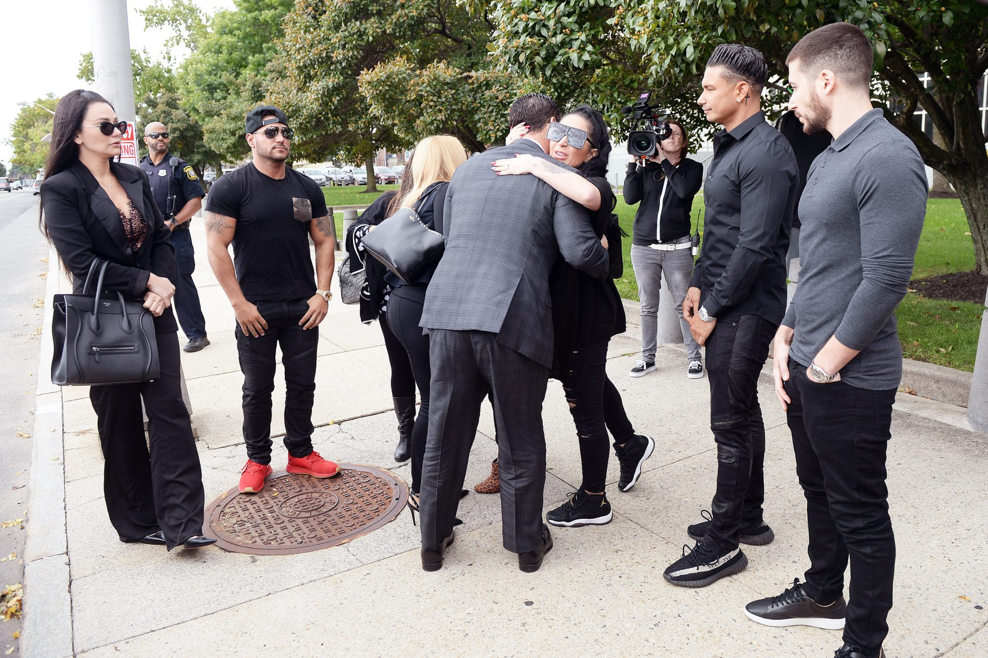 (Jersey Shore Members huging Mike (The Situation) Sorrentino photogaphed arriving at Newwark Nj court were he is to be sentenced for tax evasion