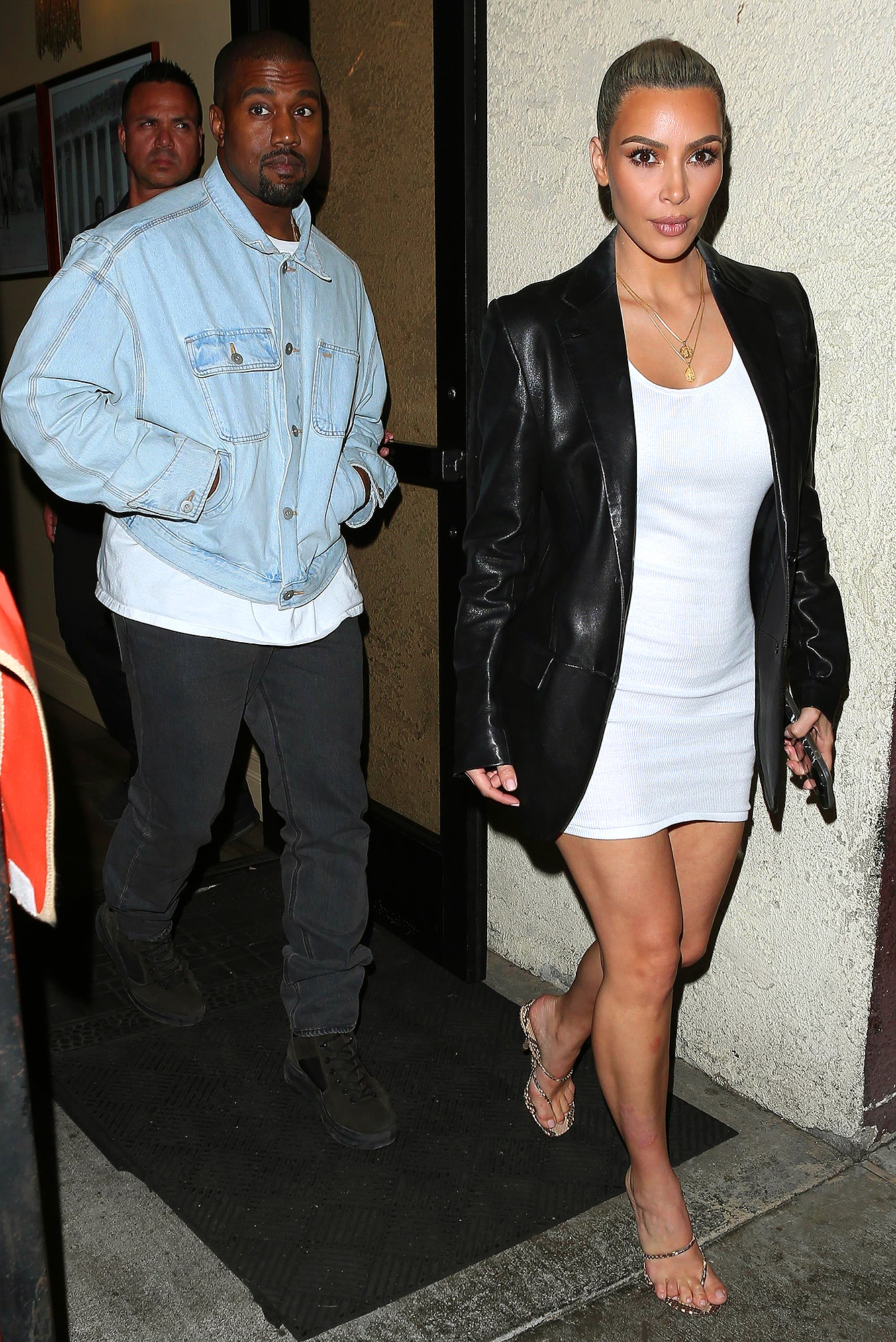 Kim Kardashian and Kanye West exit a family dinner at Carousel Restaurant