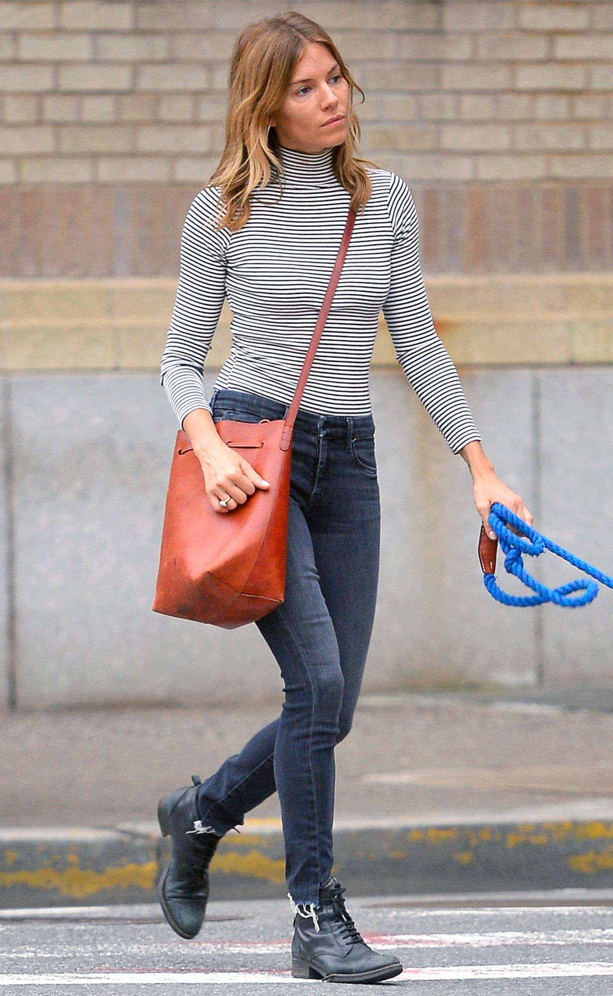 EXCLUSIVE: Sienna Miller Walks Her Dog Wearing A Striped Top Black Skinny Pants And Black Boots In The West Village In New York City