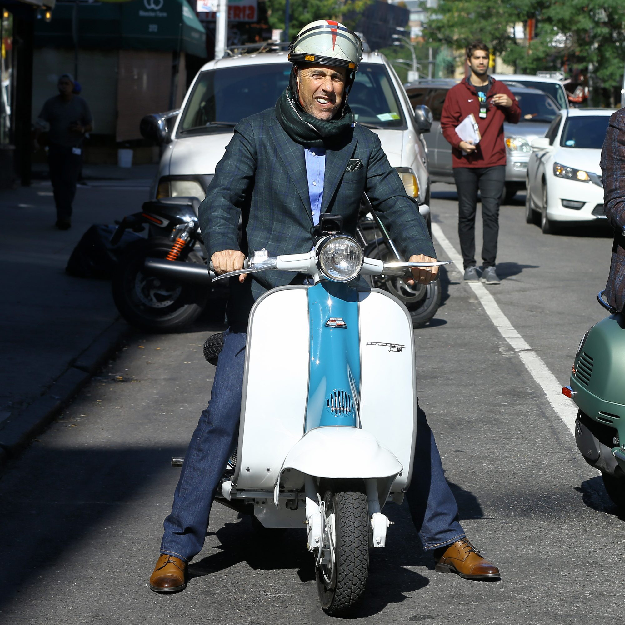 Comedians Jerry Seinfeld and Sebastian Maniscalco ride Vespa scooters while filming 'Coffee with Comedians' on Bleecker Street in New York City, New York on October 17,  2018.