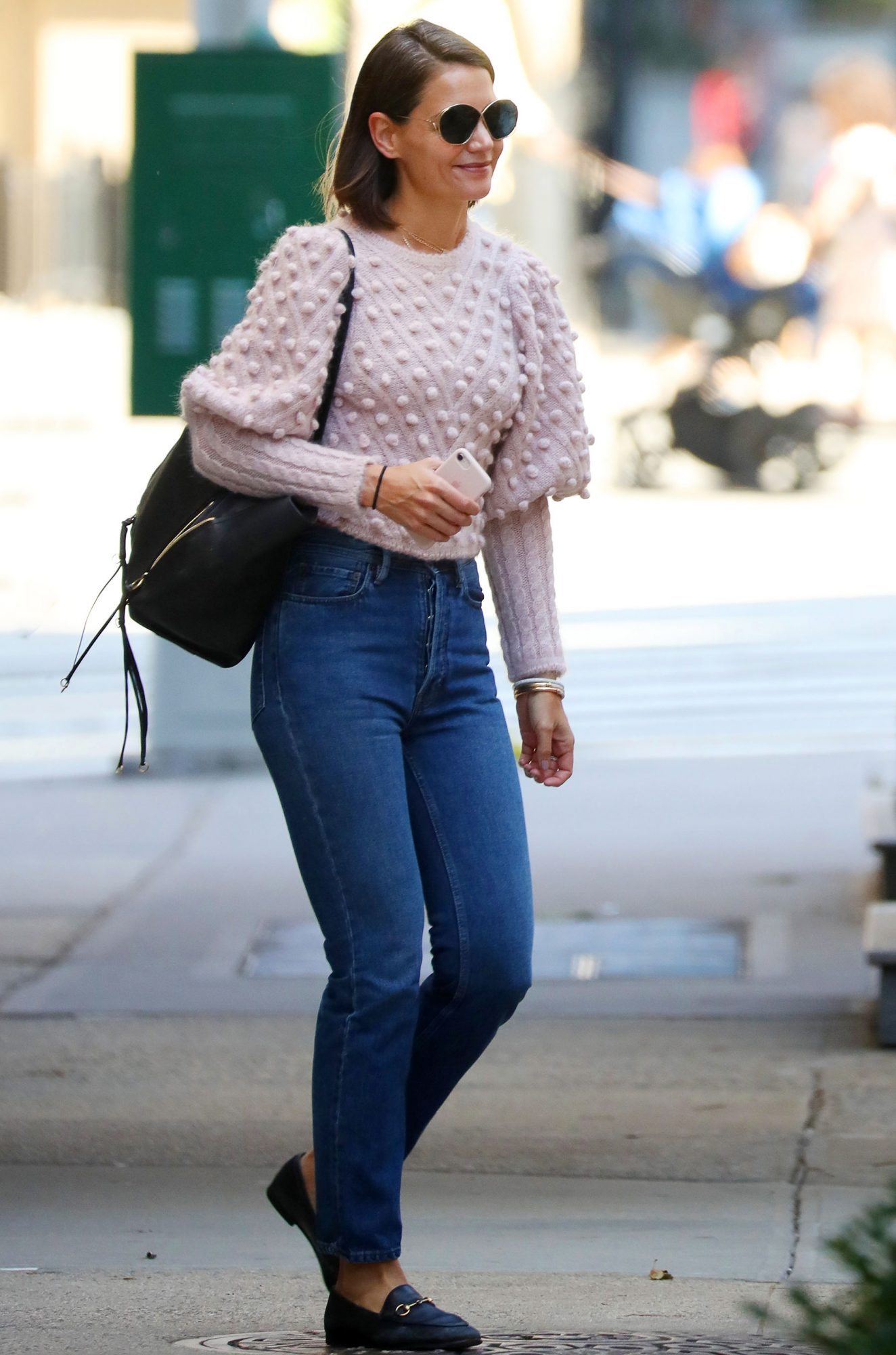 EXCLUSIVE: Katie Holmes steps out in a sweater and jeans in 80 degree weather in NYC.