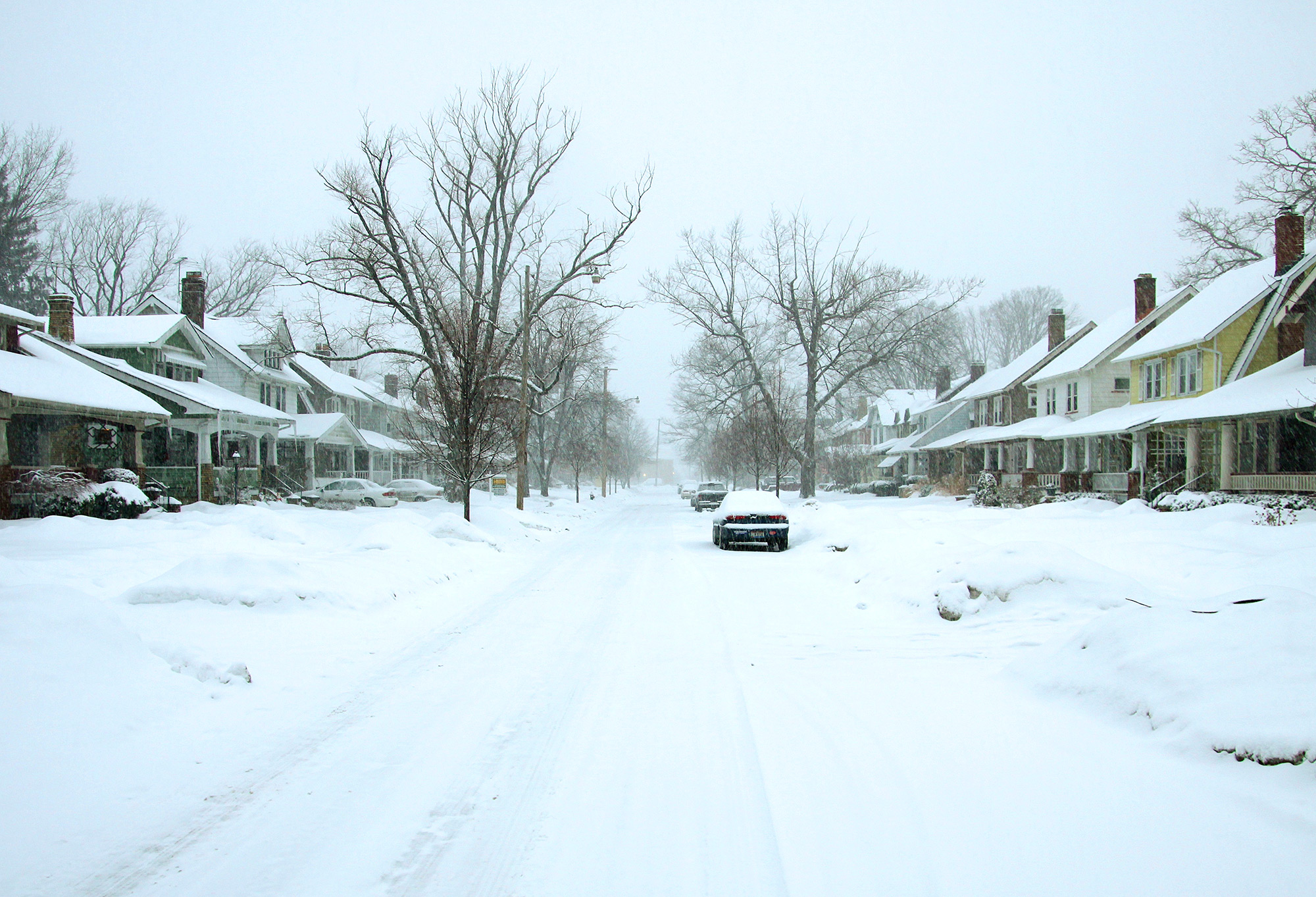 Residential street covered in a blanket of snow after the storm
